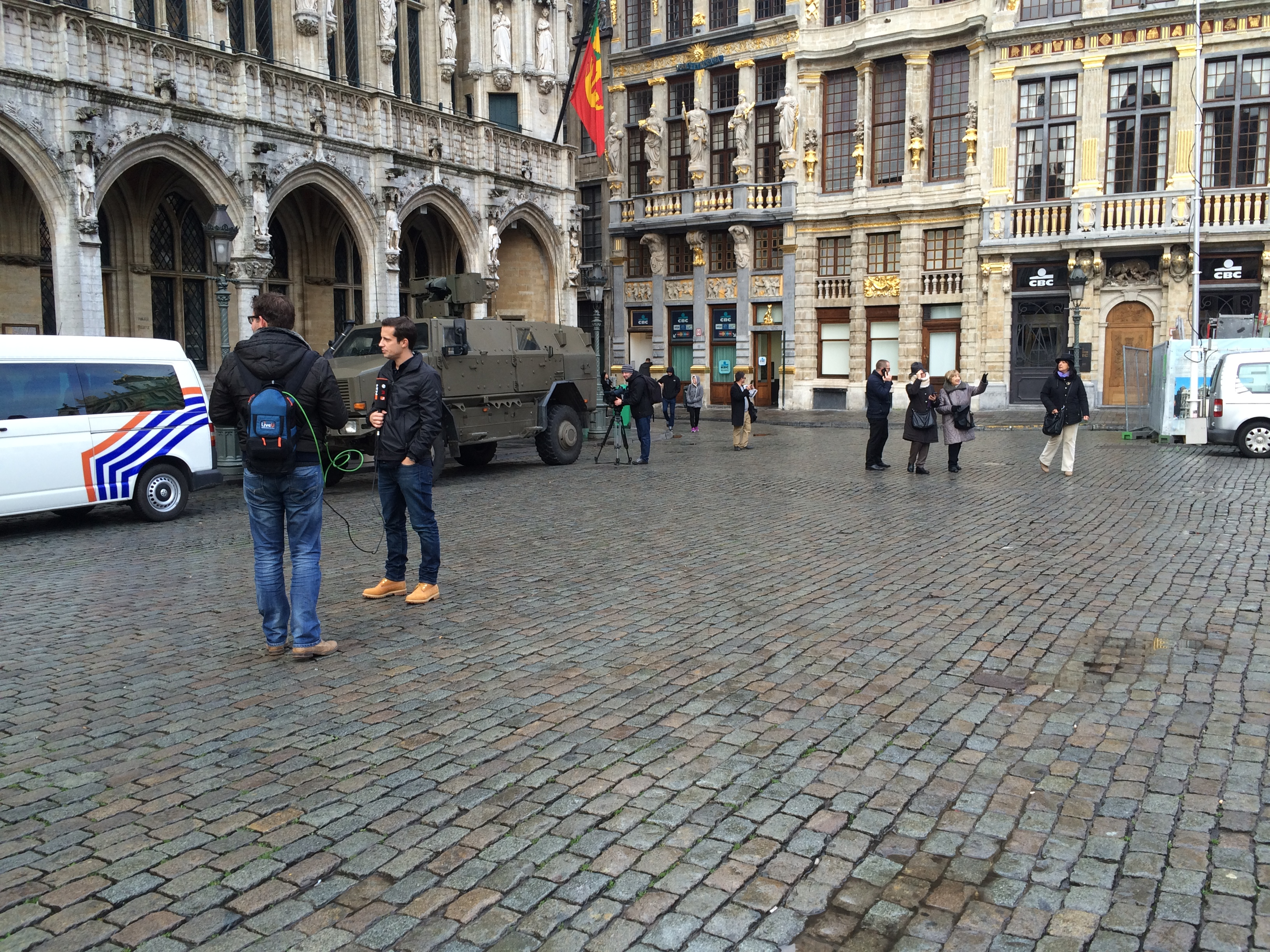 Tanks guard tourist centers in Brussels, Belgium, Nov. 22, 2015, while journalists prepare to report on an event they hope will not happen.