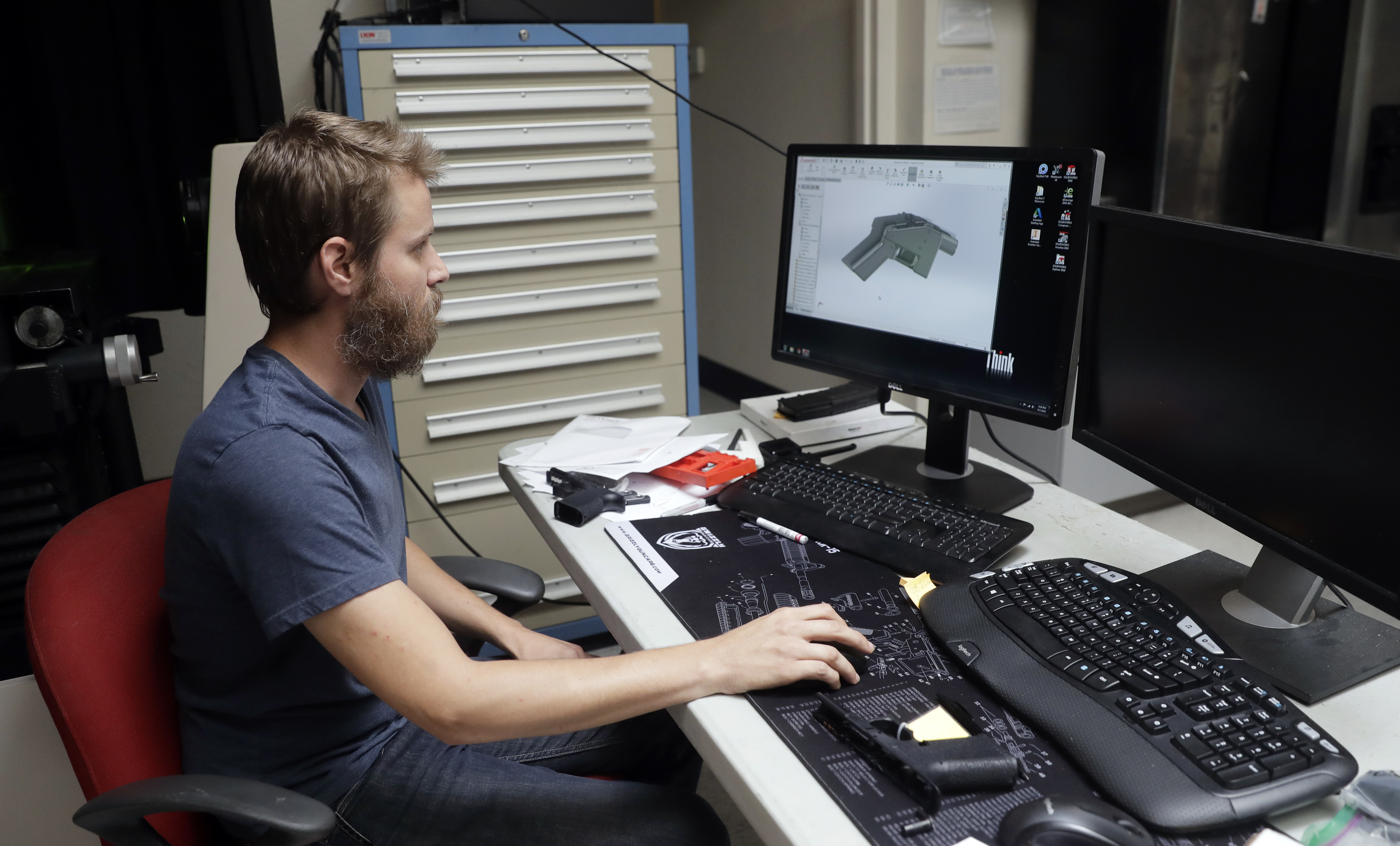 Ben Chalker shows the CAD software of a 3D-printable gun called the Liberator in Austin, Texas, Aug. 1, 2018.