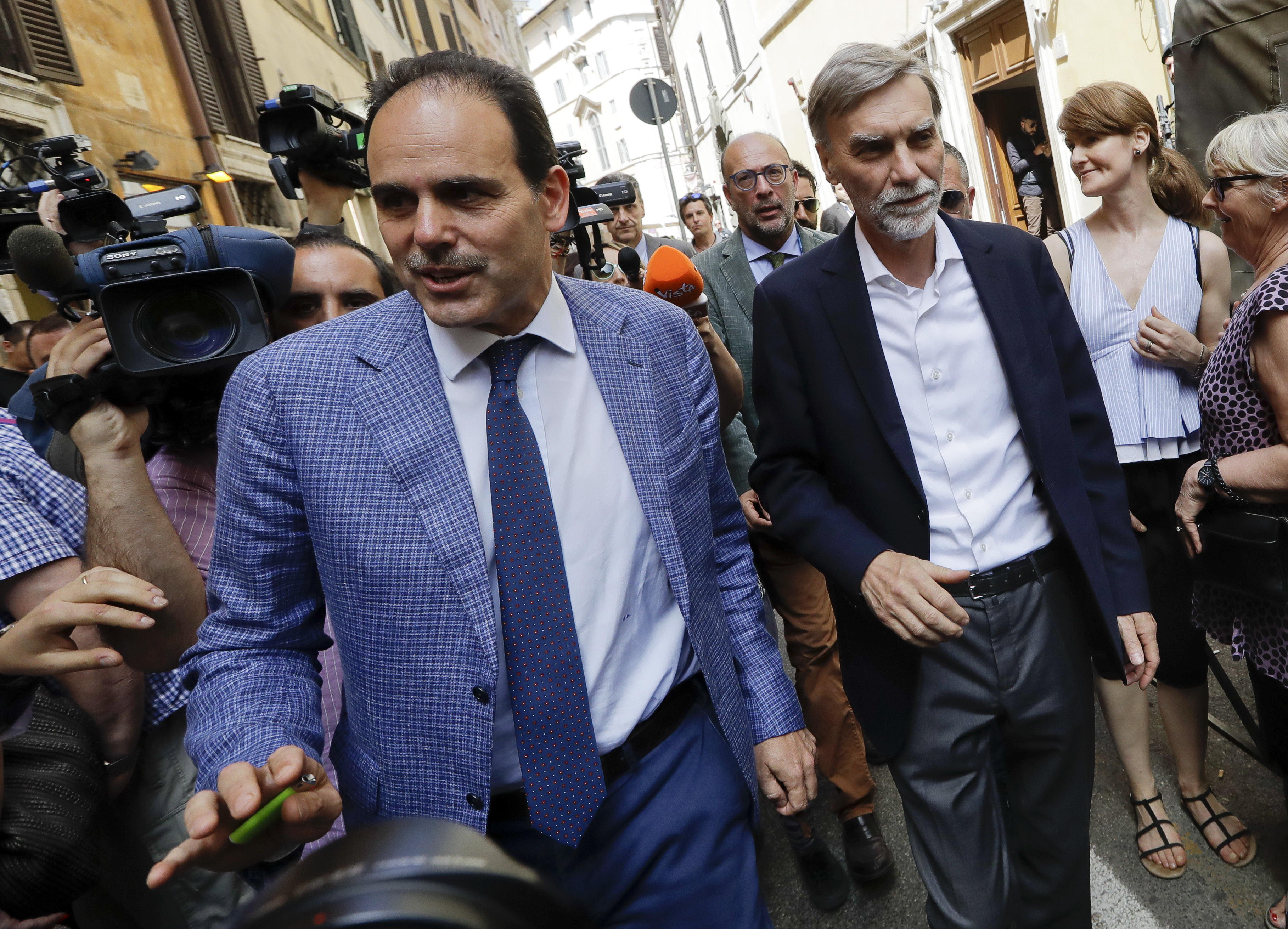 Democratic Party members Andrea Marcucci, left, group leader at the Italian Senate and Graziano Delrio group leader at the Lower Chamber walk in Rome, April 24, 2018.