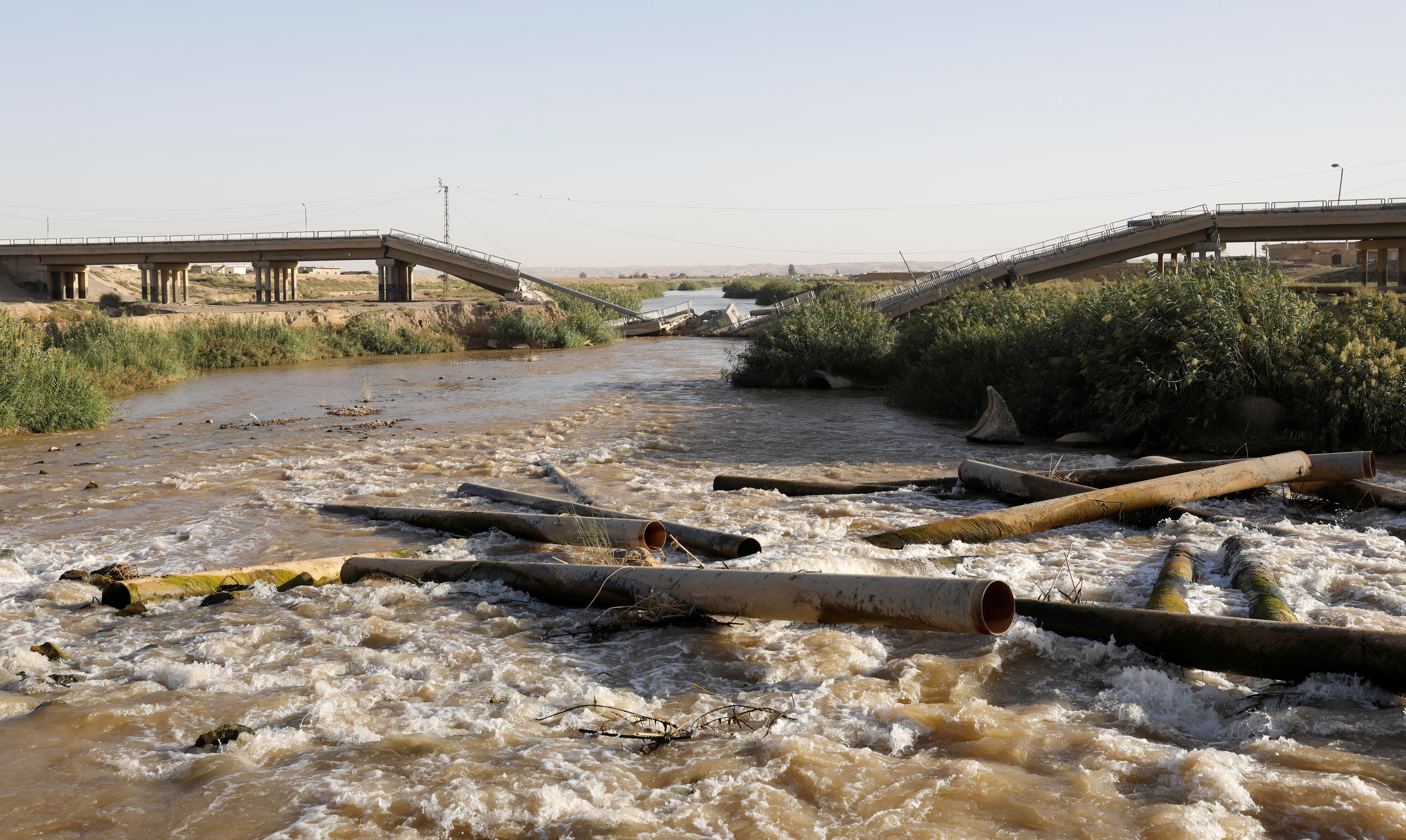 FILE - A bridge destroyed by an U.S. air strike is pictured in the outskirts east of Raqqa, Syria, Oct. 5, 2017.
