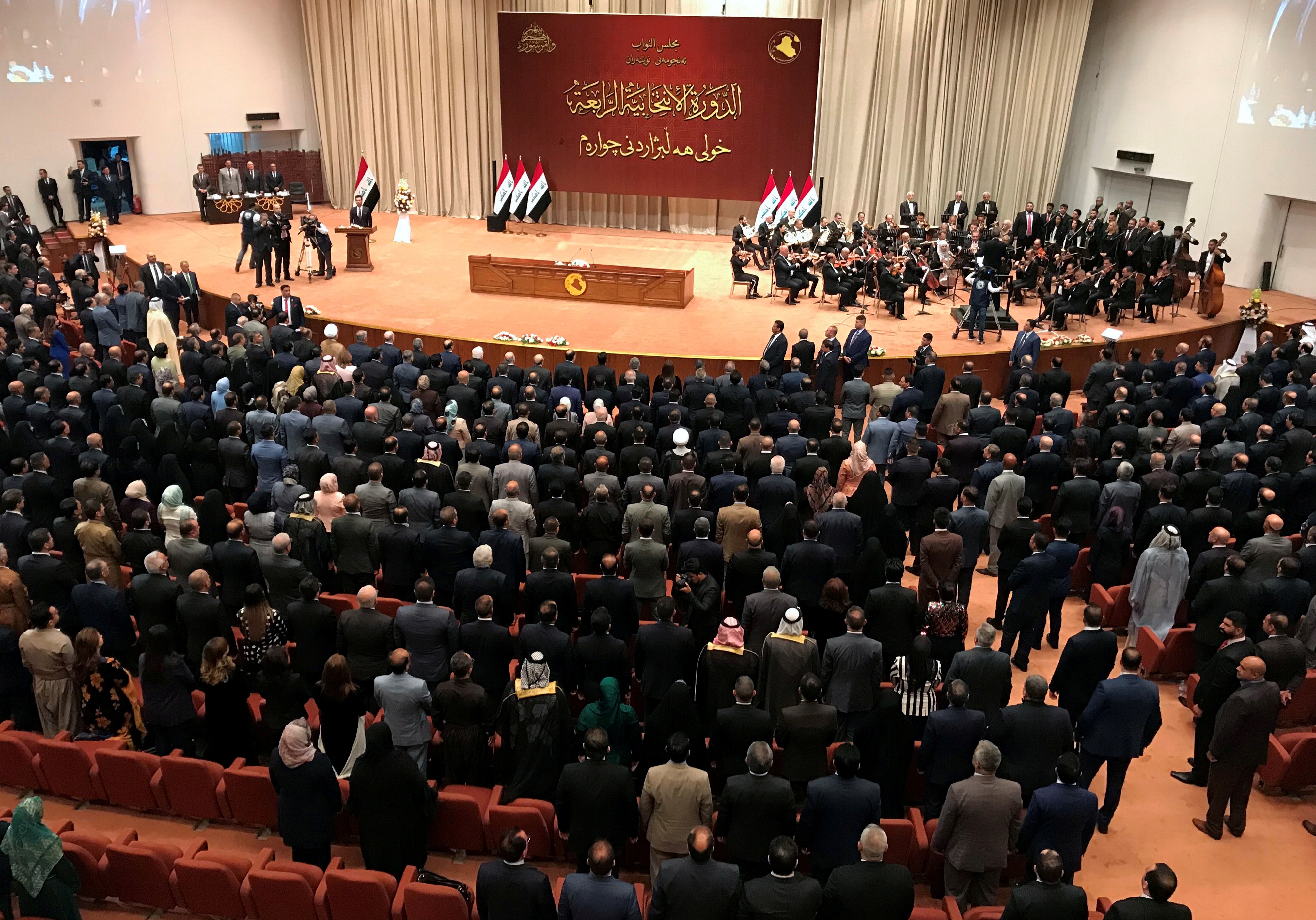 FILE PHOTO: Iraqi lawmakers are seen during the first session of the new Iraqi parliament in Baghdad,  Sept. 3, 2018.