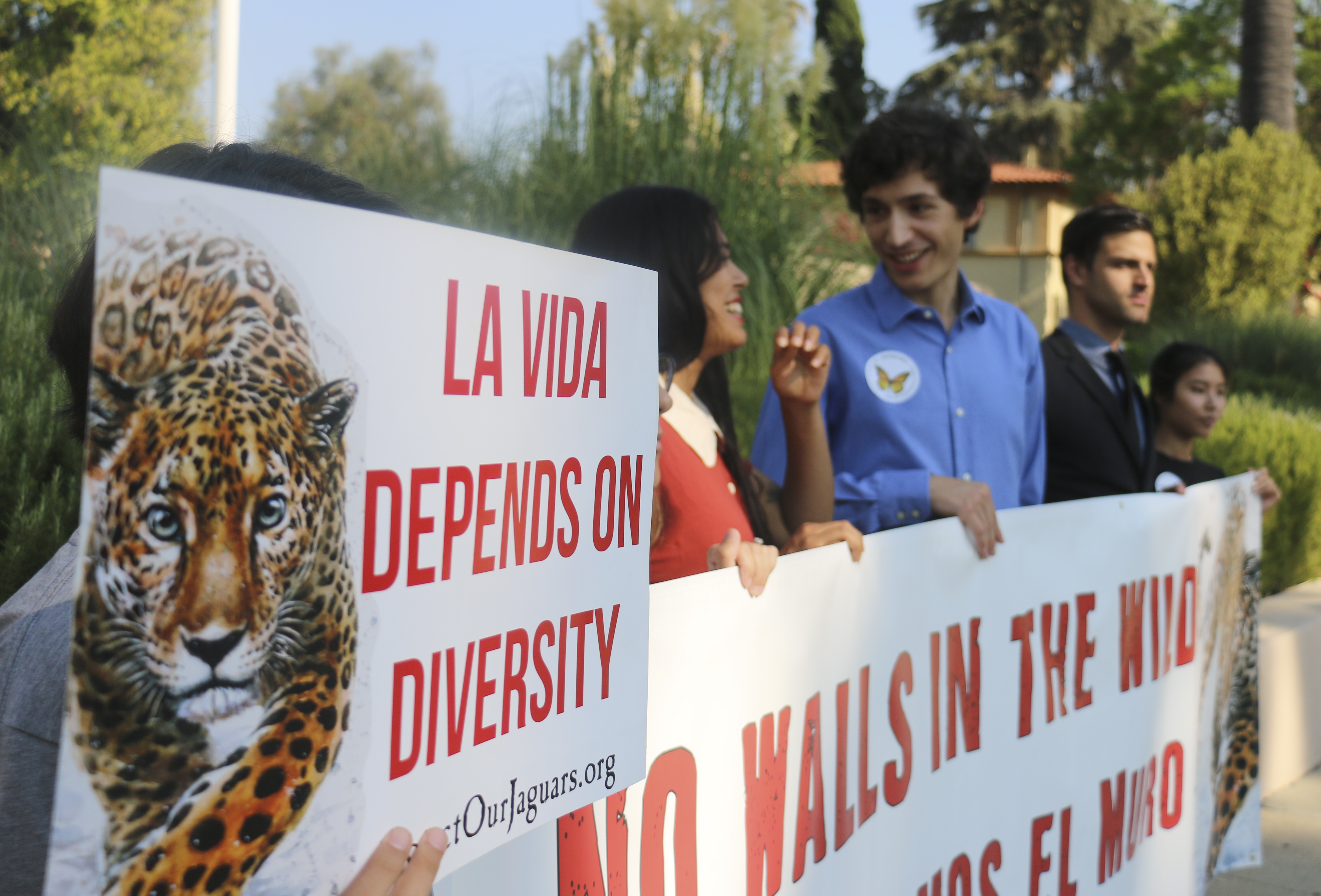 File photo shows environmental and immigration protesters in Pasadena, California, Aug. 7, 2018.