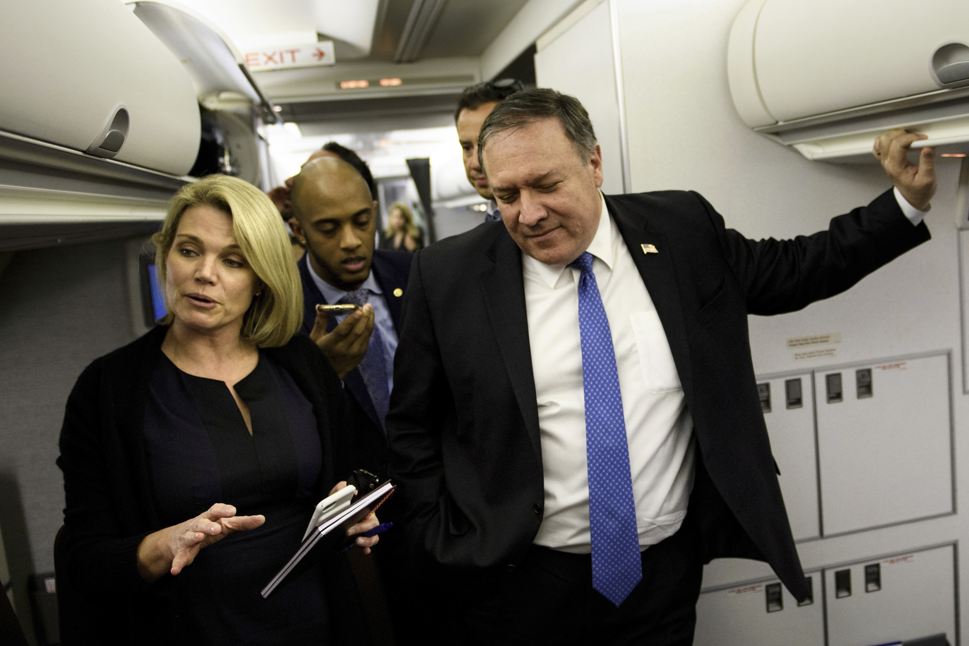 FILE - State Deptartment spokesperson Heather Nauert, left, and Secretary of State Mike Pompeo speak with reporters in his plane while flying from Panama to Mexico, Oct. 18, 2018.