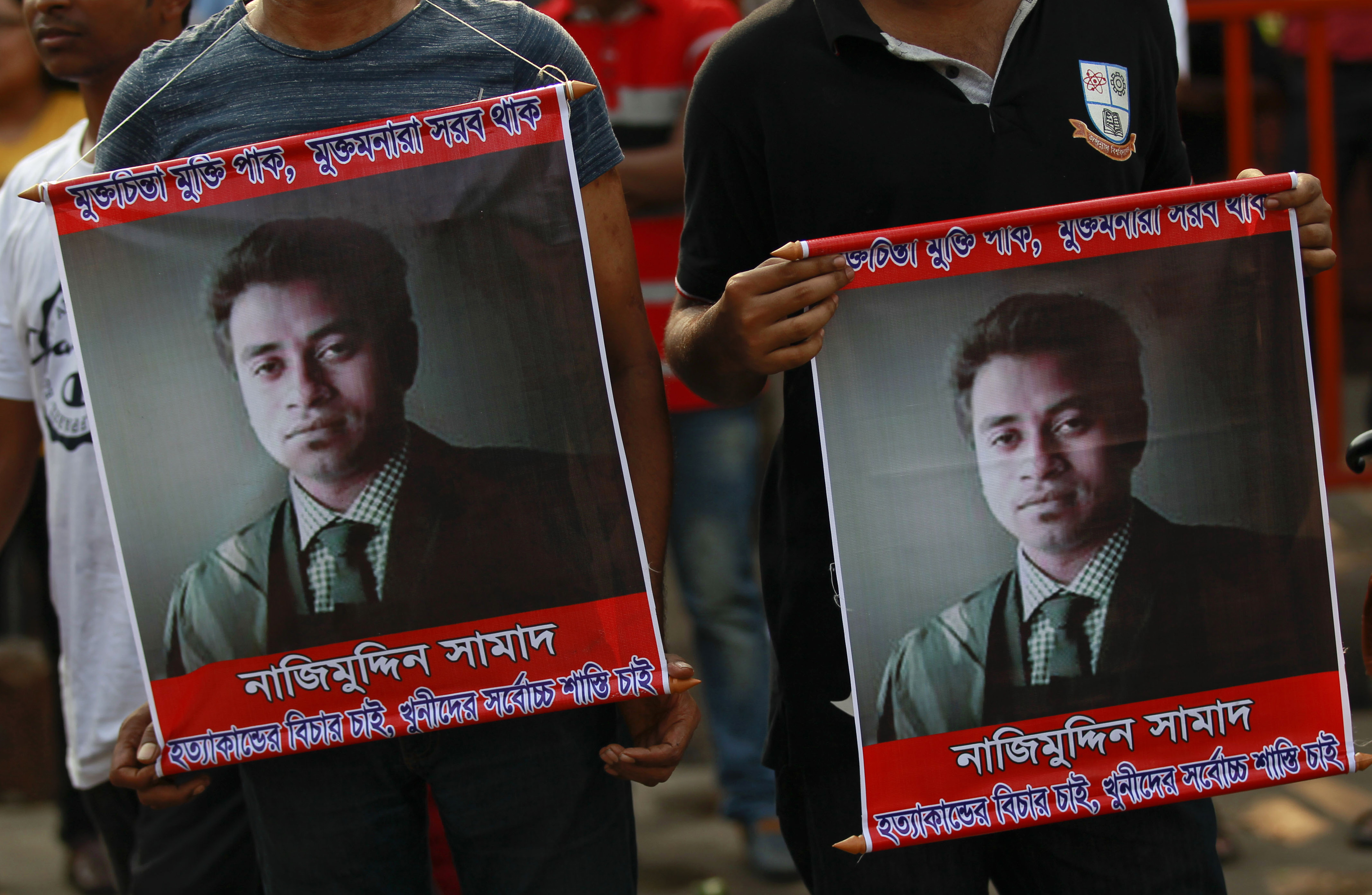 People carry portraits of student activist Nazimuddin Samad as they attend a rally to demand arrest of three motorcycle-riding assailants who hacked and shot Samad to death, in Dhaka, Bangladesh, April 8, 2016.