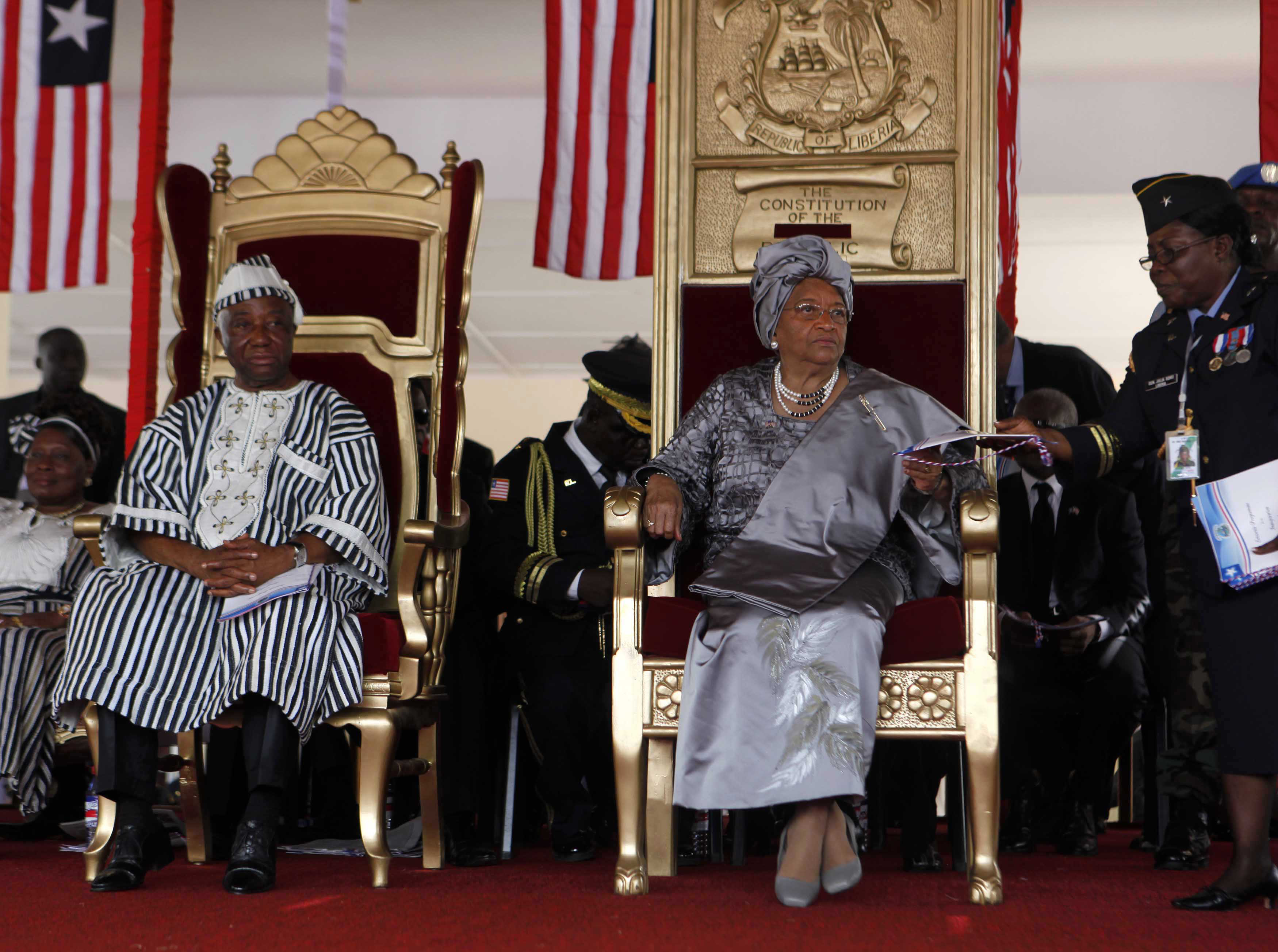 FILE - Liberian President Ellen Johnson-Sirleaf (seated R) and Liberian Vice President Joseph N. Boakai (L) attend Sirleaf's second presidential inauguration at the Capitol in Monrovia, Jan. 16, 2012.