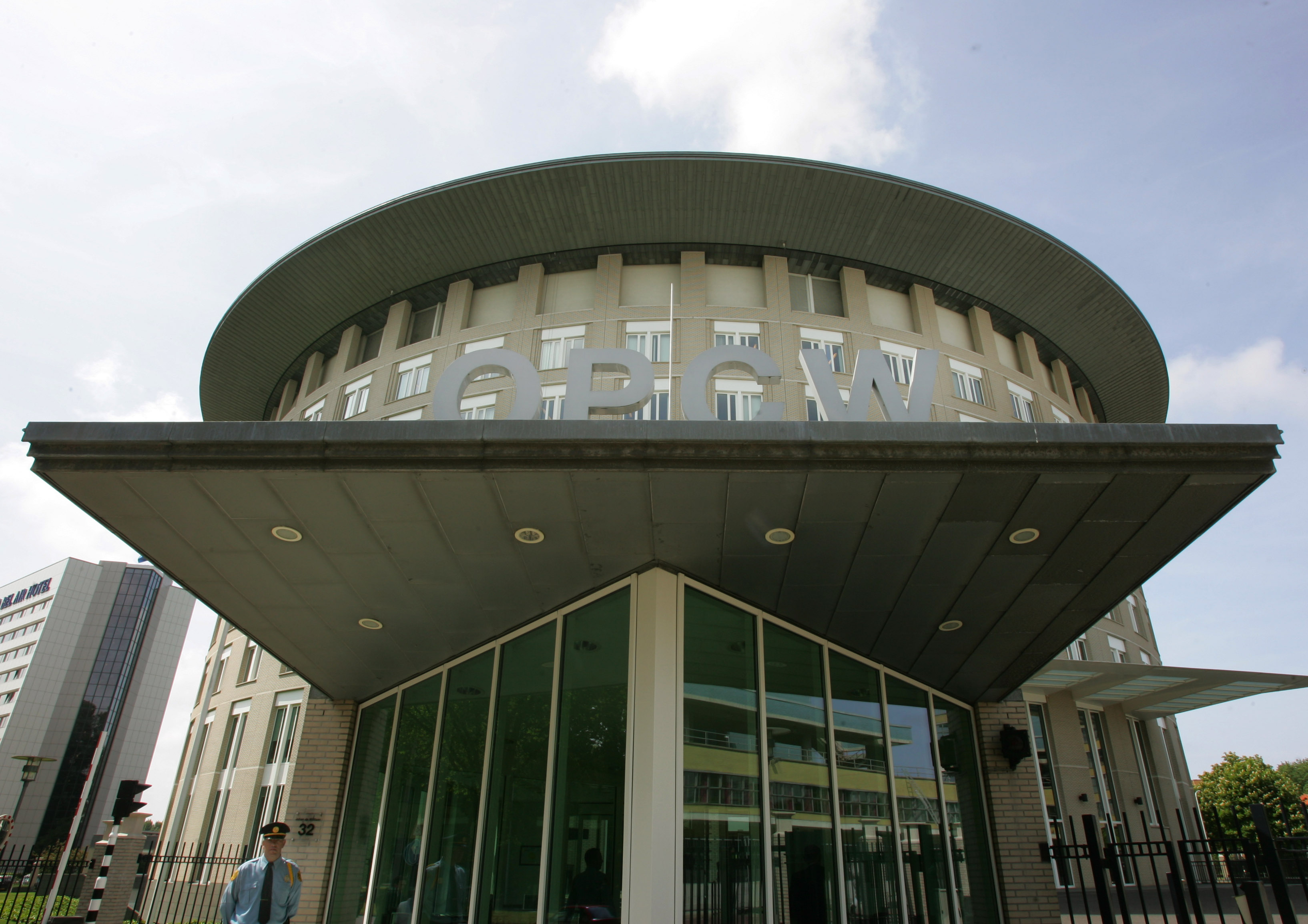 A security guard is seen at the OPCW headquarters in The Hague, Netherlands, Tuesday May 9, 2007. The world's chemical weapons watchdog is celebrating 10 years since the adoption of the treaty intended to banish such weapons from the world's arsenals...