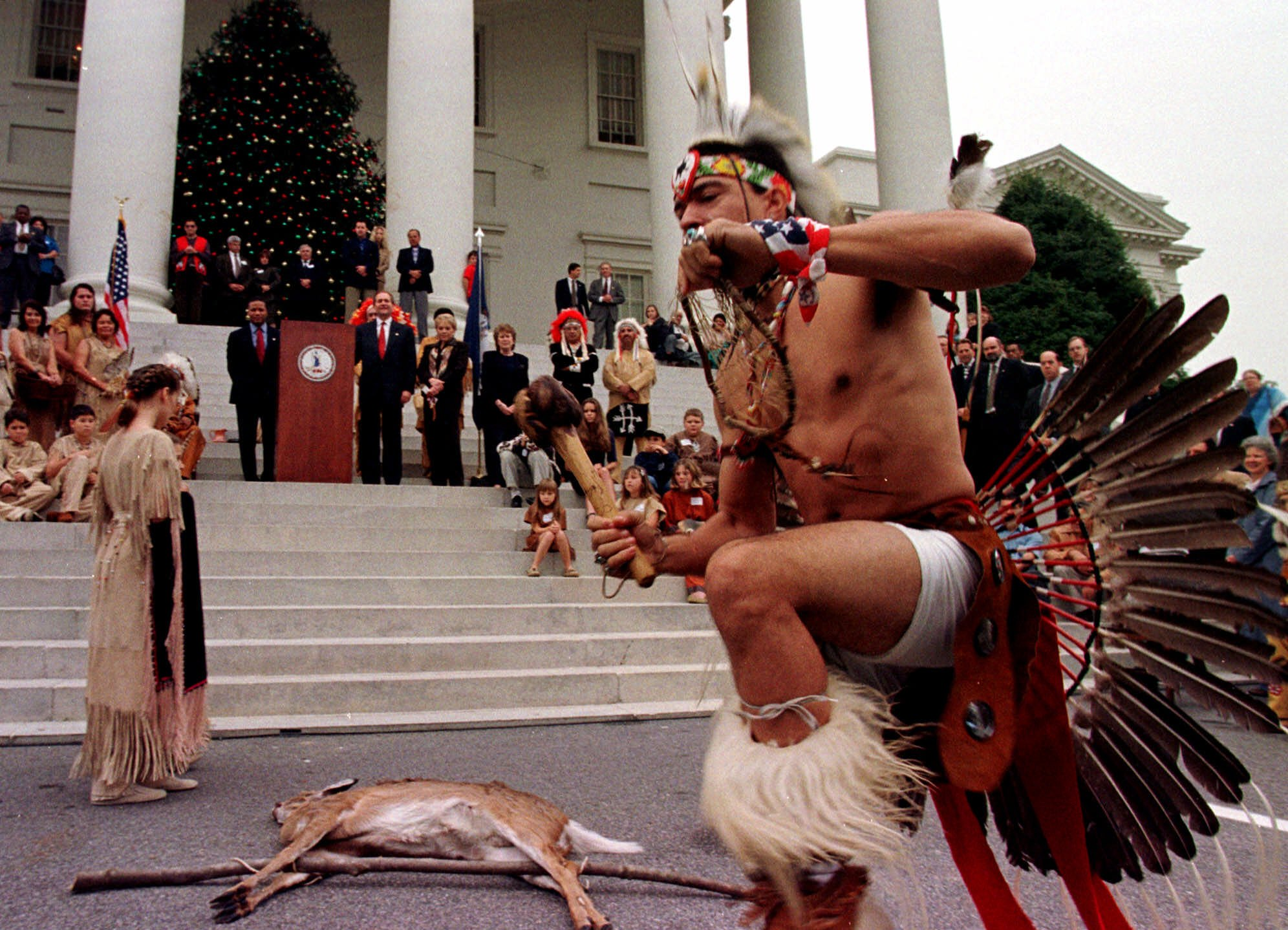 Chickahominy Indian Preston Adkins preforms a ritual dance for Va. Gov. Jim Gilmore, during the annual tax tribute at the Capitol in Richmond, Va., Wednesday Nov. 24, 1999. Virginia Indian tribes have been paying the annual tax tribute since the trea...