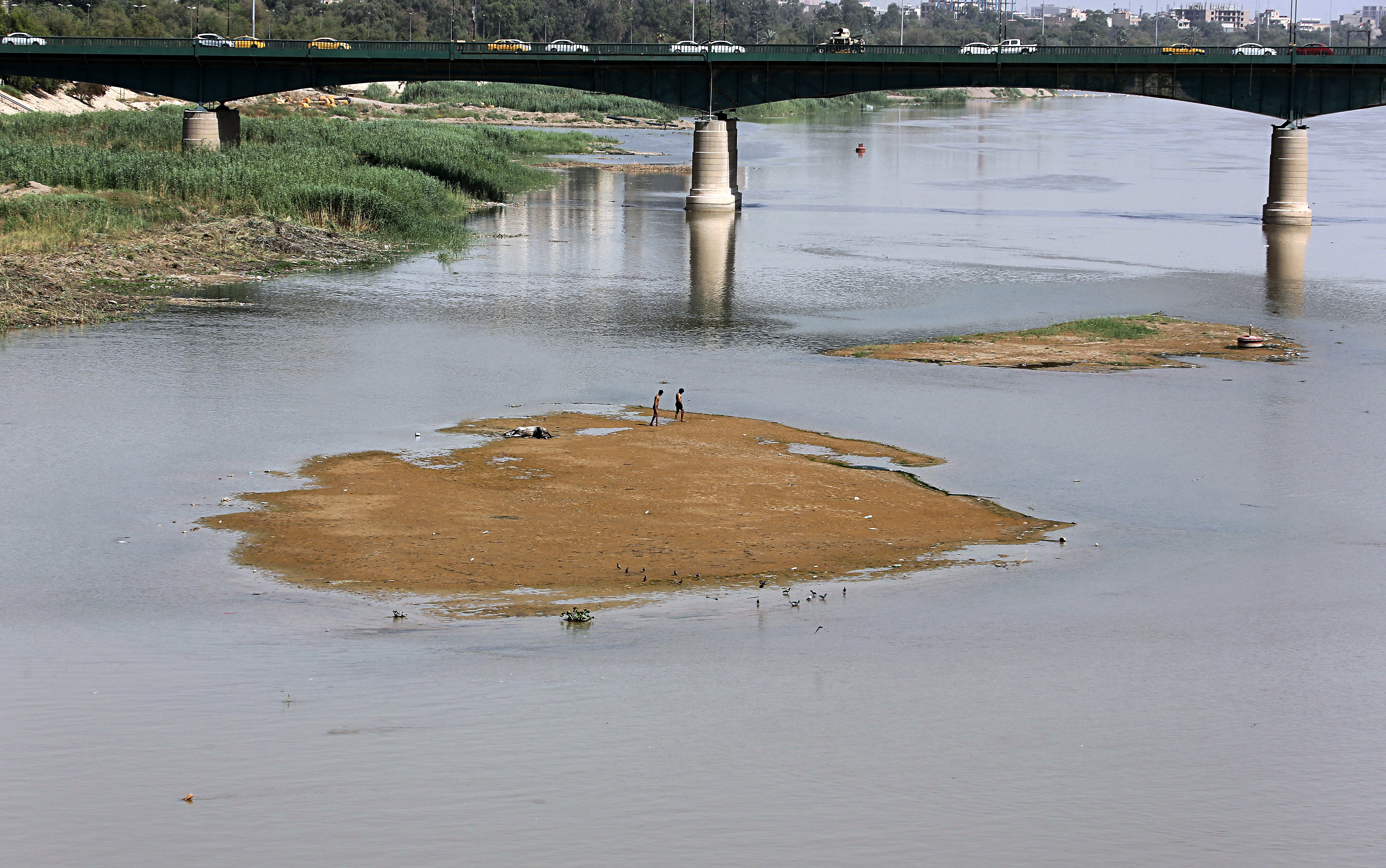 FILE - Significantly lower water levels are seen on the Tigris River, in Baghdad, Iraq, June 5, 2018.