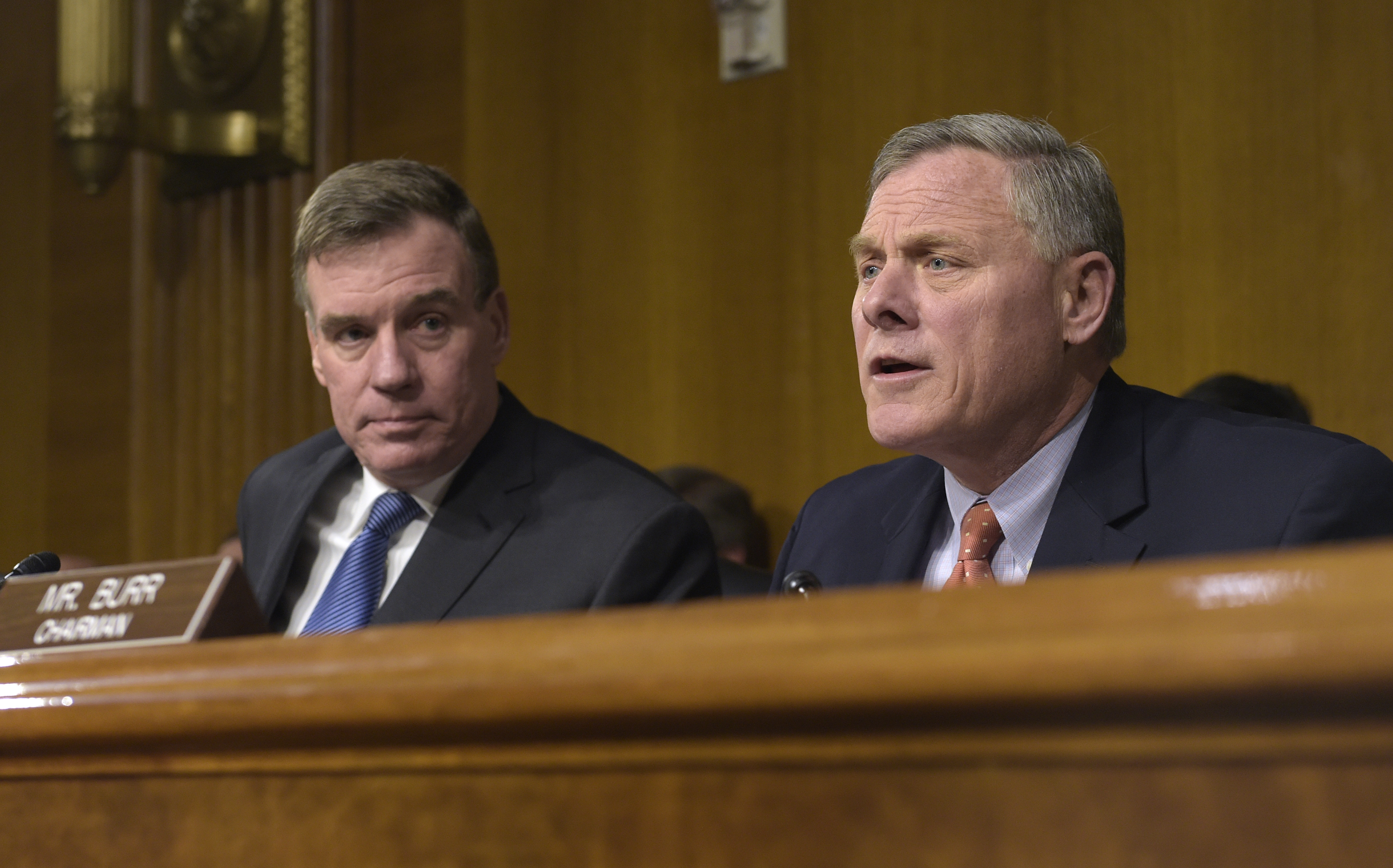 FILE - Senate Intelligence Committee Chairman. Sen. Richard Burr, R-N.C., right, joined by Vice Chairman Sen. Mark Warner, D-Va., left, speaks at the Senate Intelligence Committee hearing on Capitol Hill in Washington, March 30, 2017.