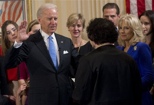 Vice President Joe Biden takes the oath of office during the 57th Presidential Inauguration official swearing-in ceremony at the Naval Observatory on Sunday, January 20, 2013 in Washington. The oath is administered by US Supreme Court Justice Sonia S...