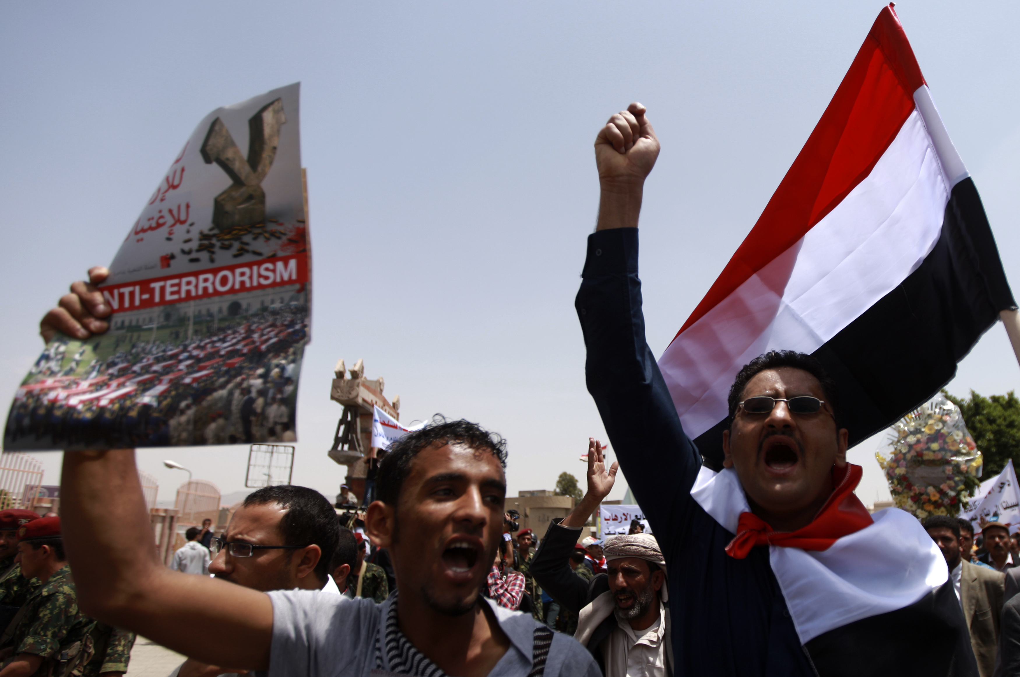 FILE - People shout slogans in support of the Yemen army and security forces in a U.S.-backed campaign against militant network al-Qaida in the Arabian Peninsula (AQAP), in Sana'a, May 21, 2014.