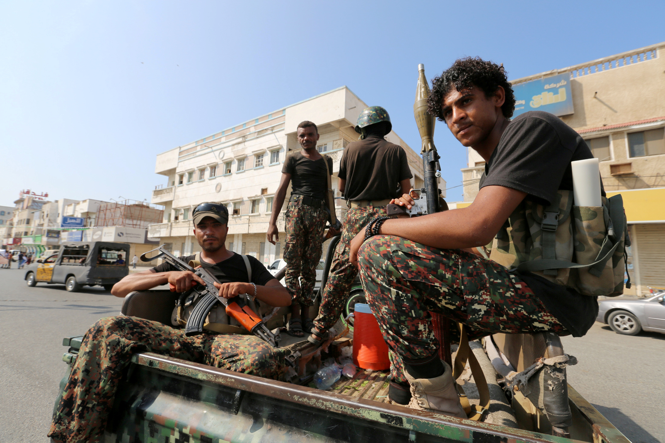 FILE PHOTO: Houthi militants patrol a street where pro-Houthi protesters demonstrated against the Saudi-led coalition in Hodeidah, Yemen Dec. 10, 2018