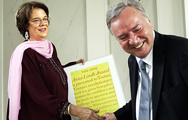FILE - American Molly Melching, from the organization Tostan, receives the 2005 Anna Lindh Award, in Stockholm,  June 16, 2005, from Bo Holmberg, widower of the late Swedish politician Anna Lindh who was murdered in 2003.