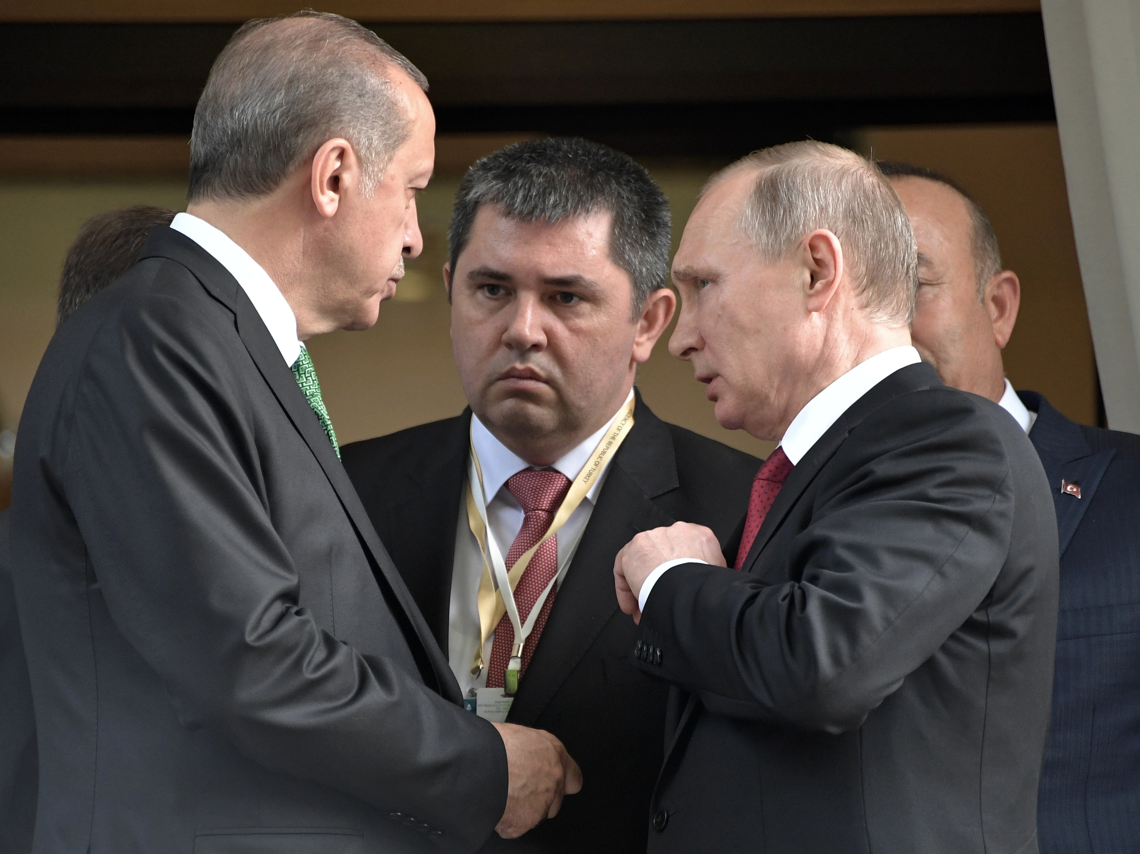 Turkish President Recep Tayyip Erdogan, left, speaks to Russian President Vladimir Putin, right, as he leaves after their meeting in Putin's residence in the Russian Black Sea resort of Sochi, Russia, Wednesday, May 3, 2017.