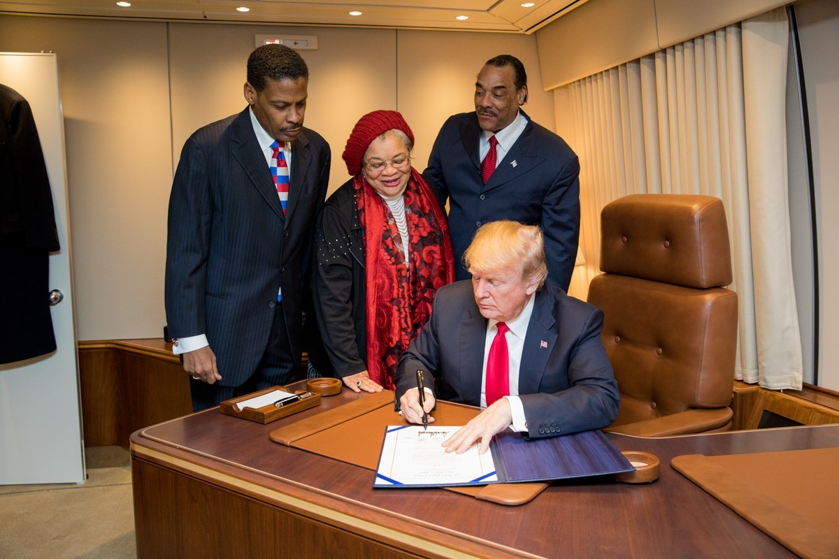 President Donald J. Trump, with Alveda King, center, niece of slain Civil Rights leader Dr. Martin Luther King Jr., and joined by Isaac Newton Farris Jr., left, nephew of Dr. King, and Bruce Levell of the  National Diversity Coalition for Trump, righ...