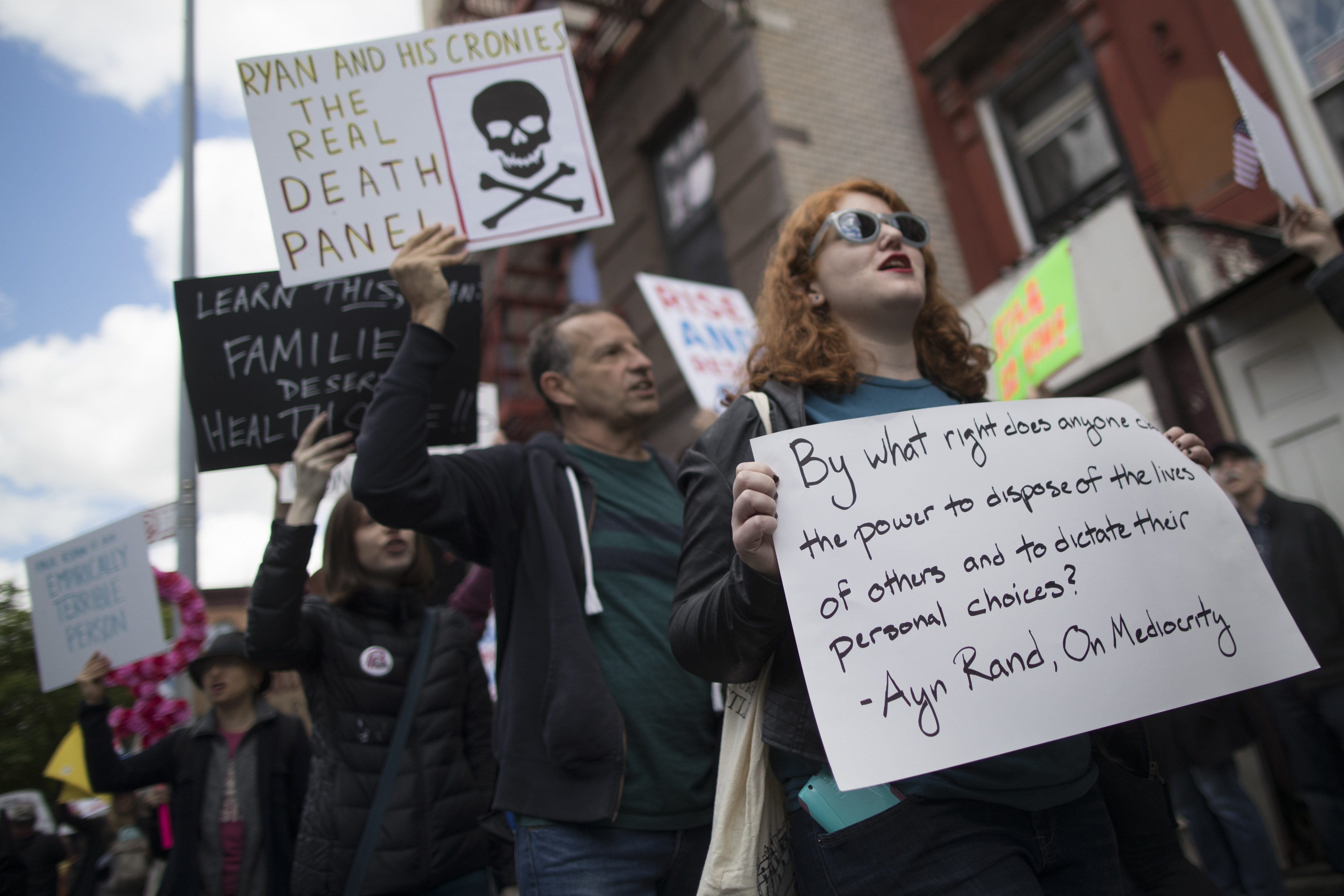FILE - Protesters chant slogans outside the Success Academy charter school before House Speaker Paul Ryan, R-Wis., arrived, May 9, 2017, in the Harlem neighborhood of New York. Ryan was visiting the school, which is run by an advocate who was conside...
