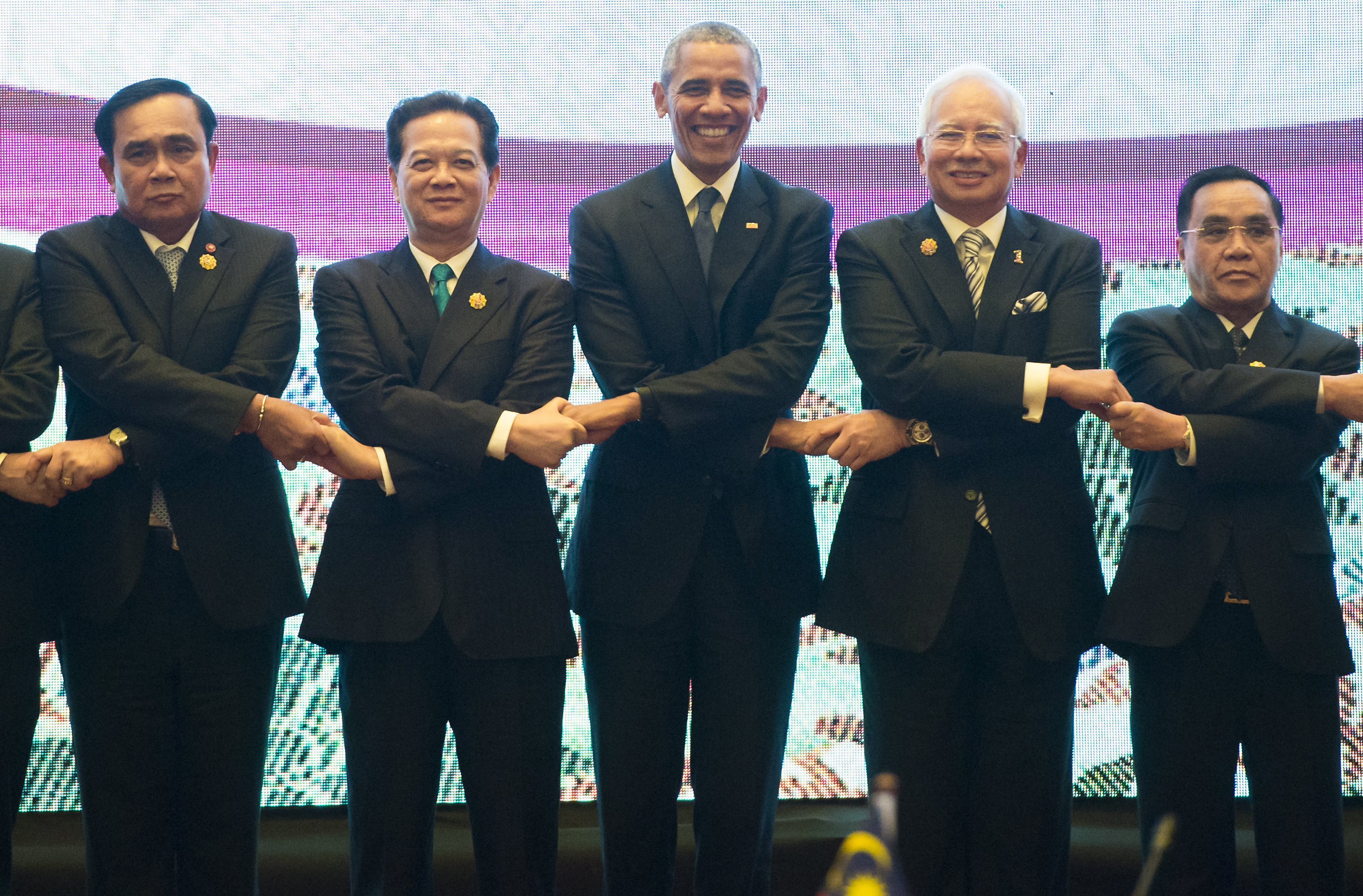U.S. President Barack Obama, center, participates in the U.S.-ASEAN Summit family photo at the Kuala Lumpur Convention Center, on the sidelines of the Association of Southeast Asian Nations (ASEAN) Summit, Nov. 21, 2015.