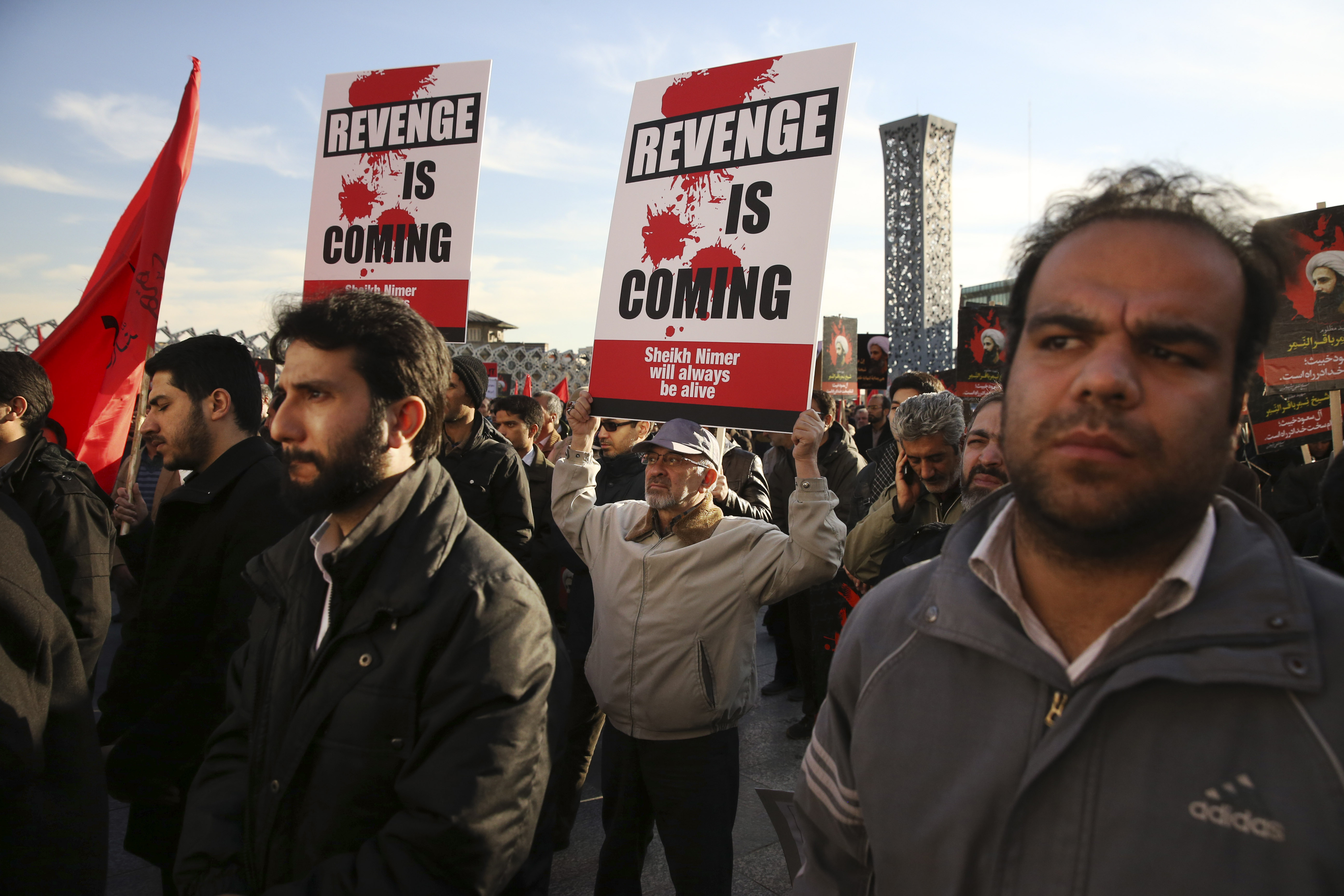 Iranian demonstrators hold anti-Saudi placards in a rally to protest the execution by Saudi Arabia last week of Sheikh Nimr al-Nimr, a prominent opposition Saudi Shiite cleric, in Tehran, Iran, Jan. 4, 2016.