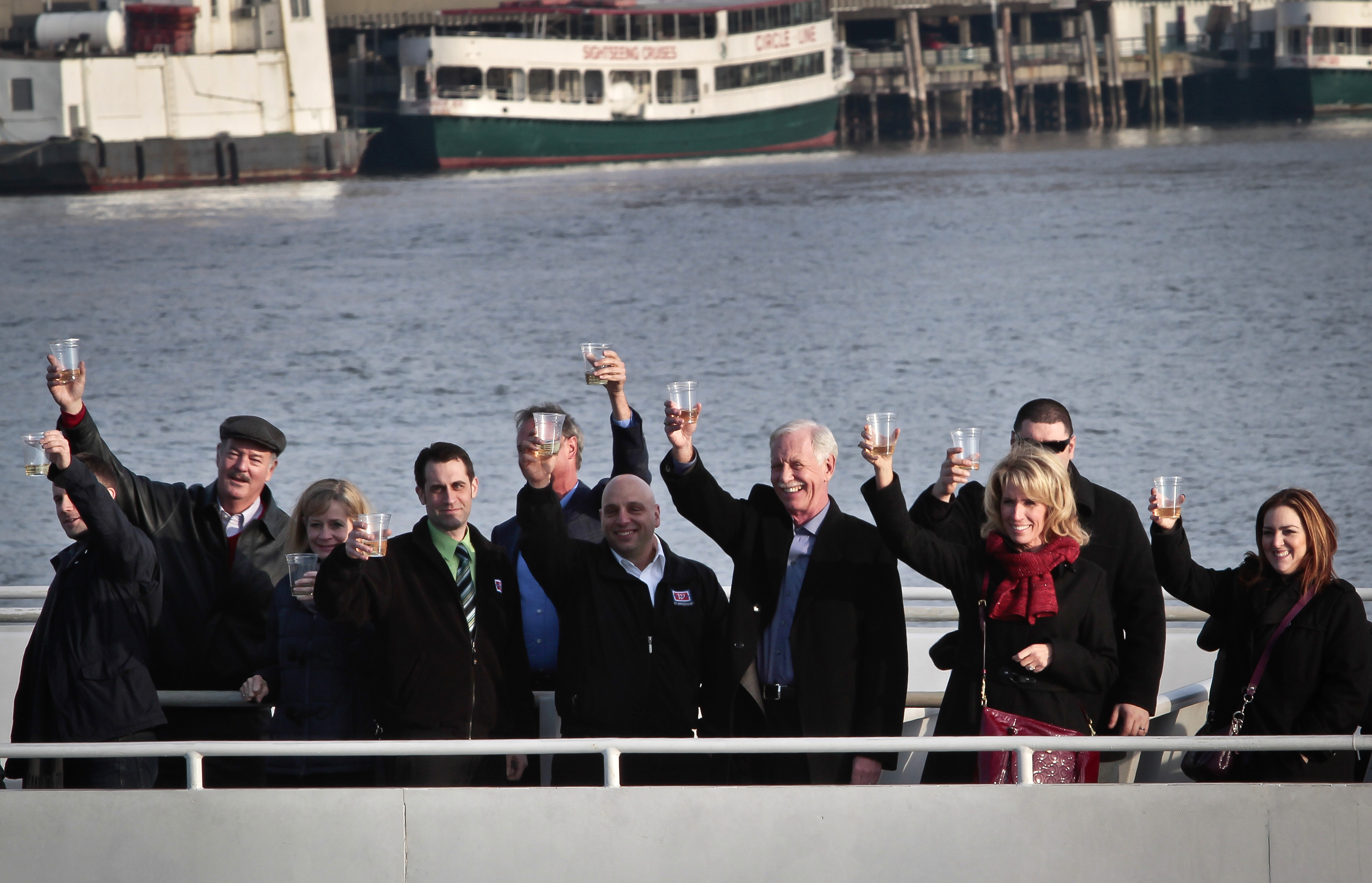 "FILE - Captain Chesley ""Sully"" Sullenberger III, fourth from right, joins survivors and rescuers in a toast marking the anniversary of the event known as the ""miracle on the Hudson,"" Jan. 15, 2014 in New York."