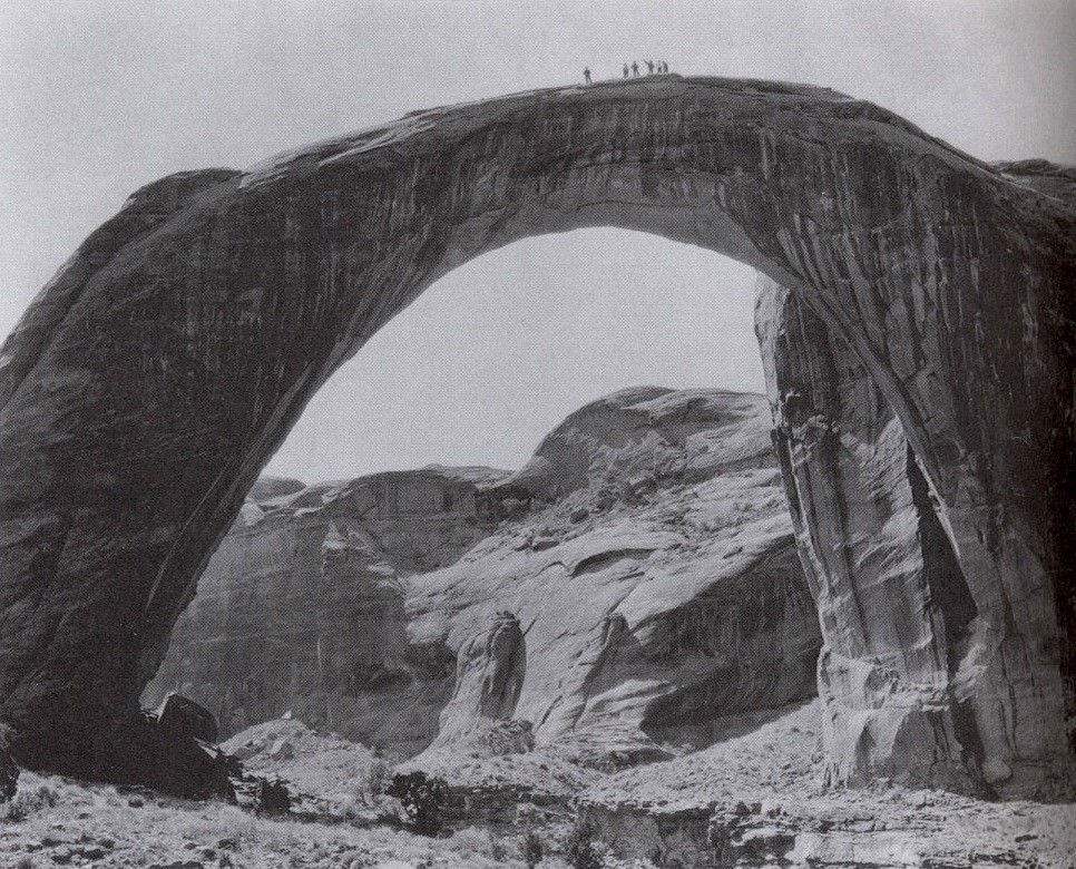 The massive stone 'rainbow' dwarfs the members of a government expedition to the arch in the first decade of the 20th century.