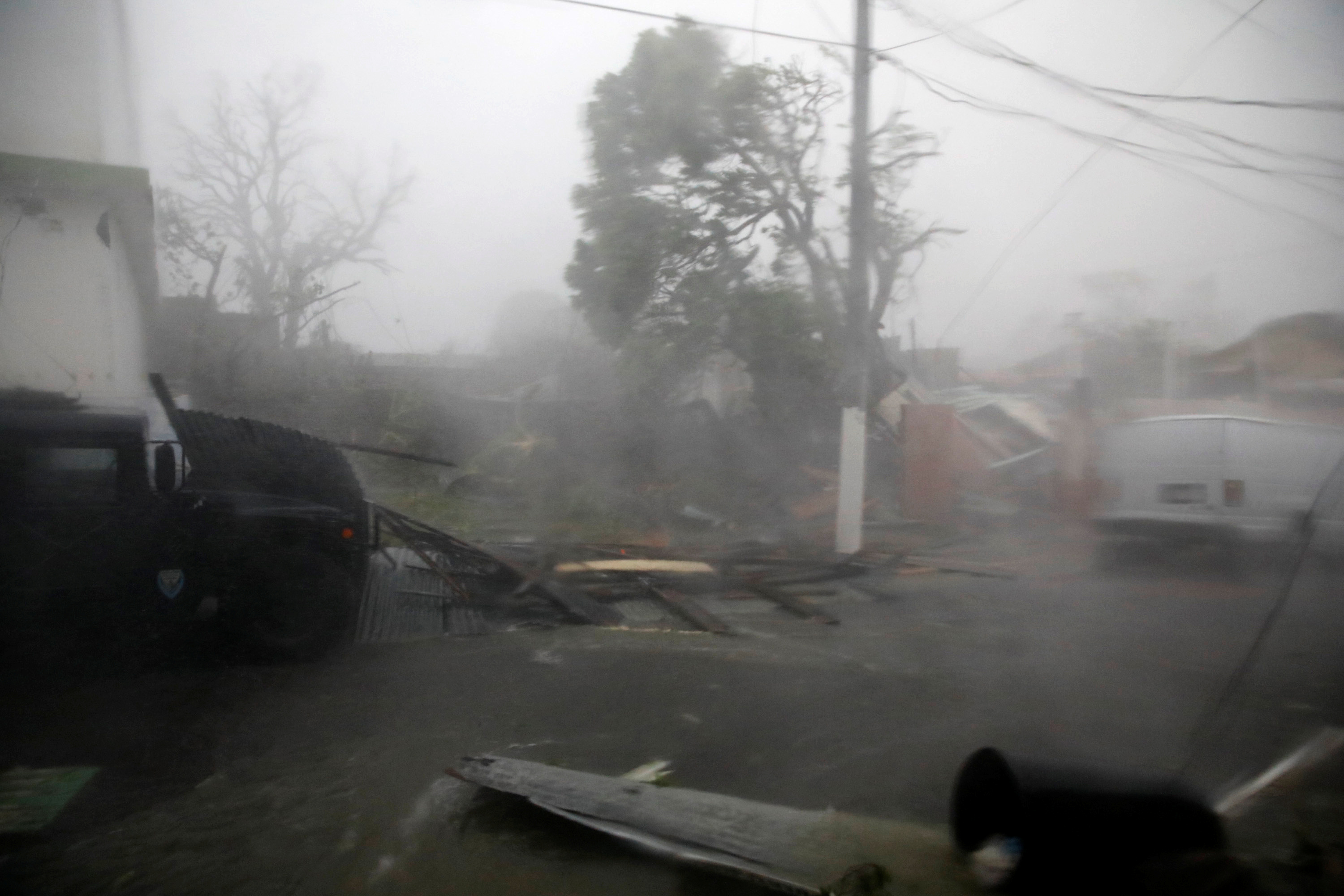 Damage and flooded streets are seen after the area was hit by Hurricane Maria in Guayama, Puerto Rico, Sept. 20, 2017.