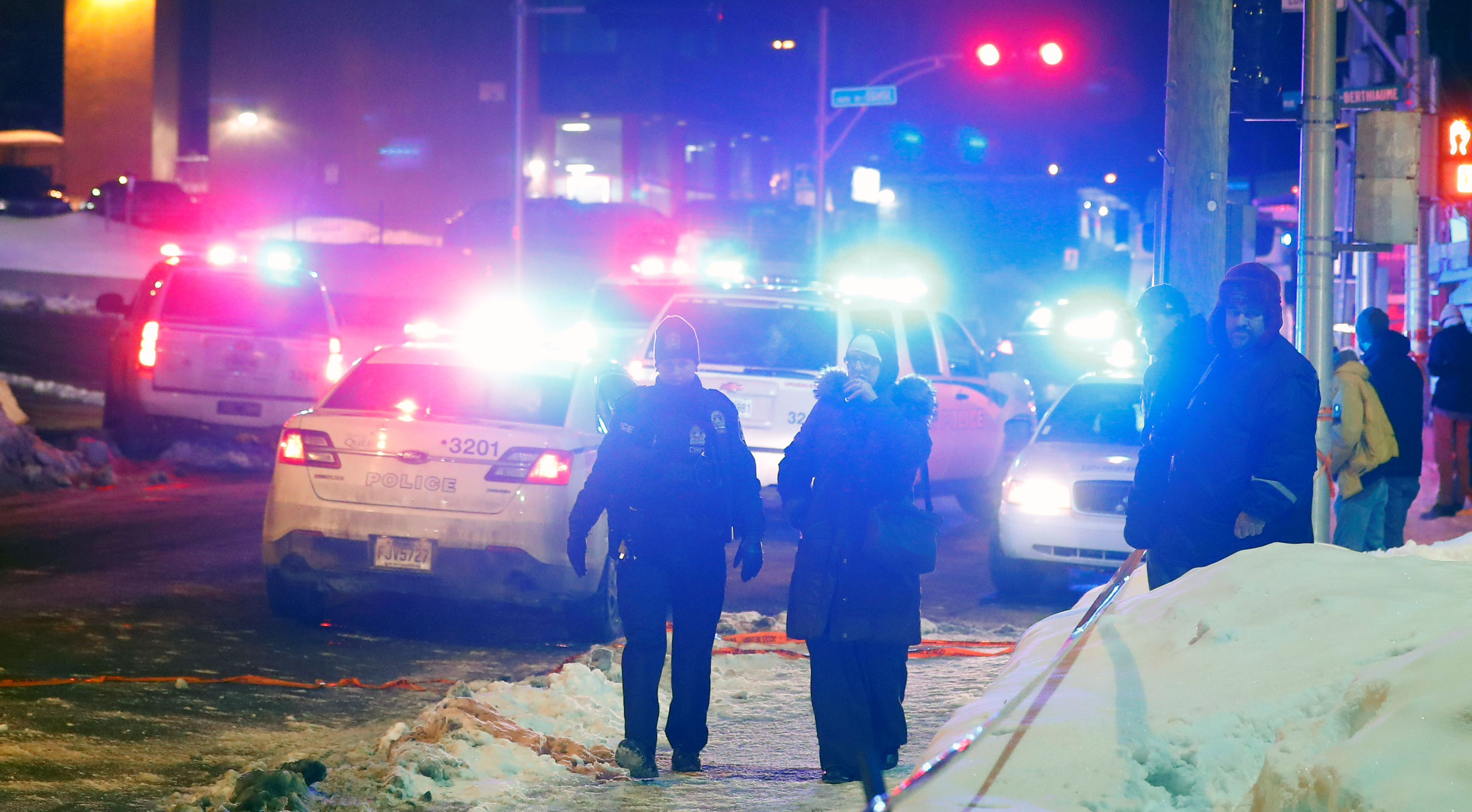 Police officers are seen near a mosque after a shooting in Quebec City, Jan. 29, 2017.