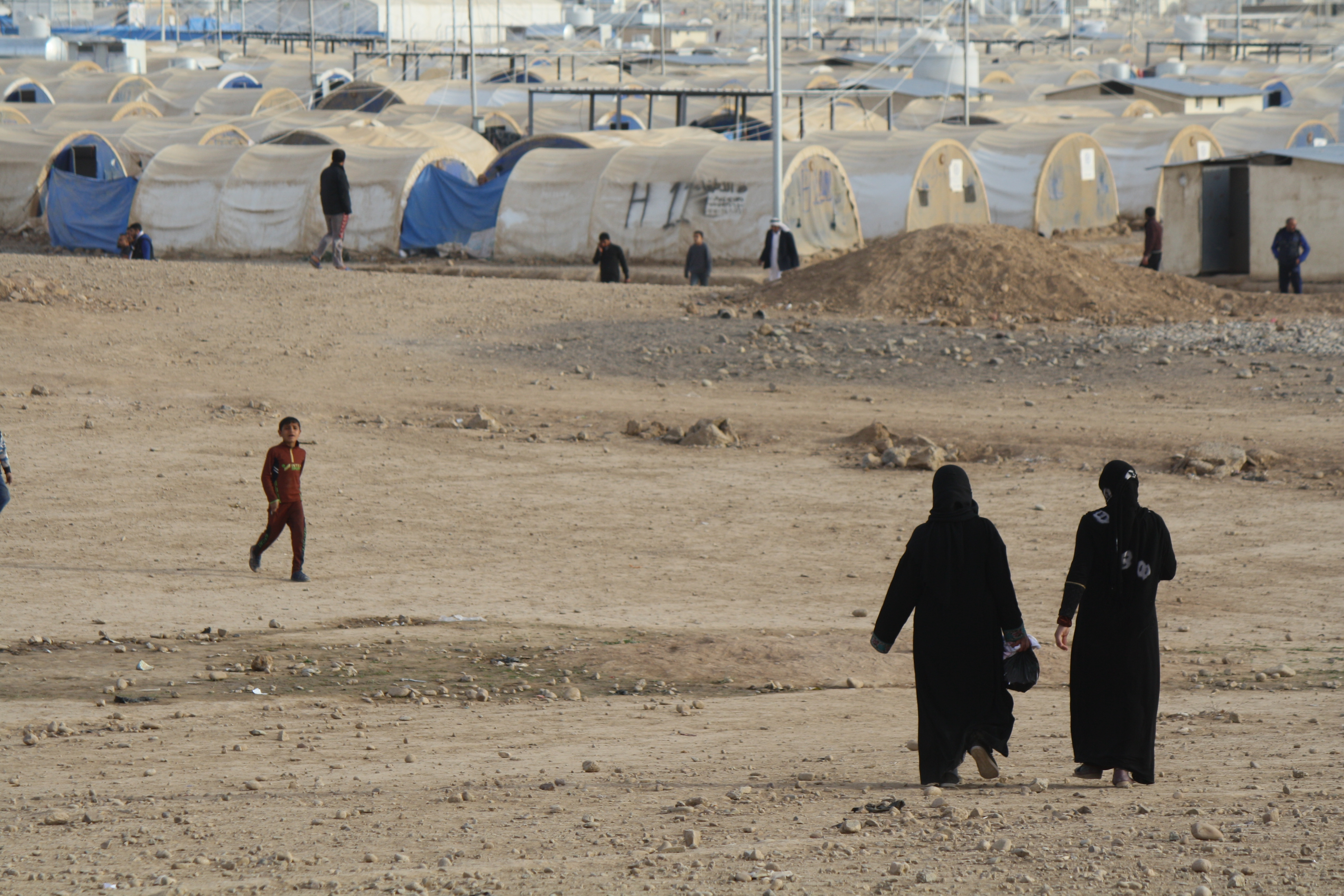 Wives of killed or captured IS fighters often continue to cover themselves in black veils in the Haj Ali camp in Northern Iraq, Dec. 27, 2017.