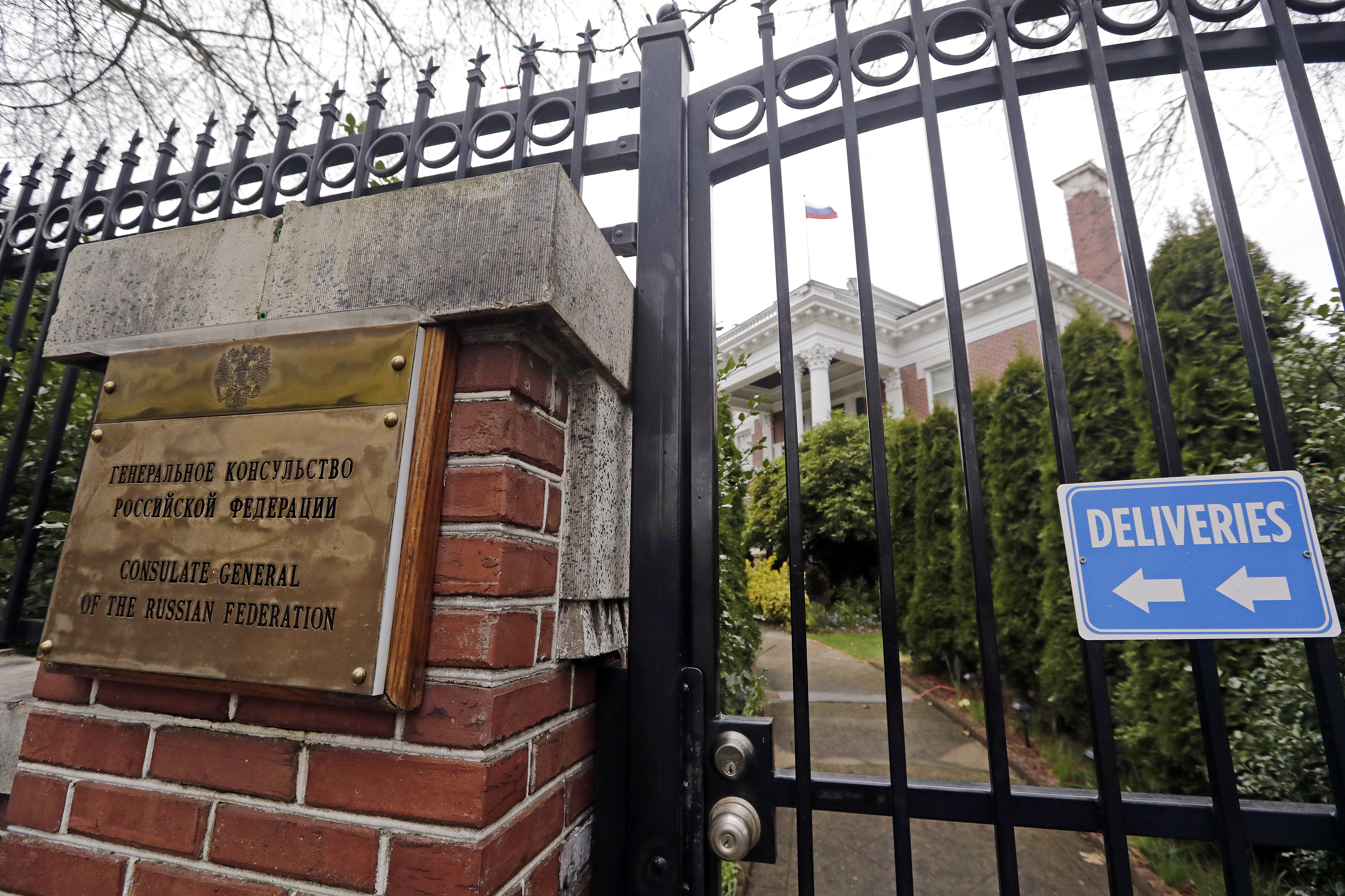 A metal fence surrounds the residence of Russia's consul general Monday, March 26, 2018, in Seattle.