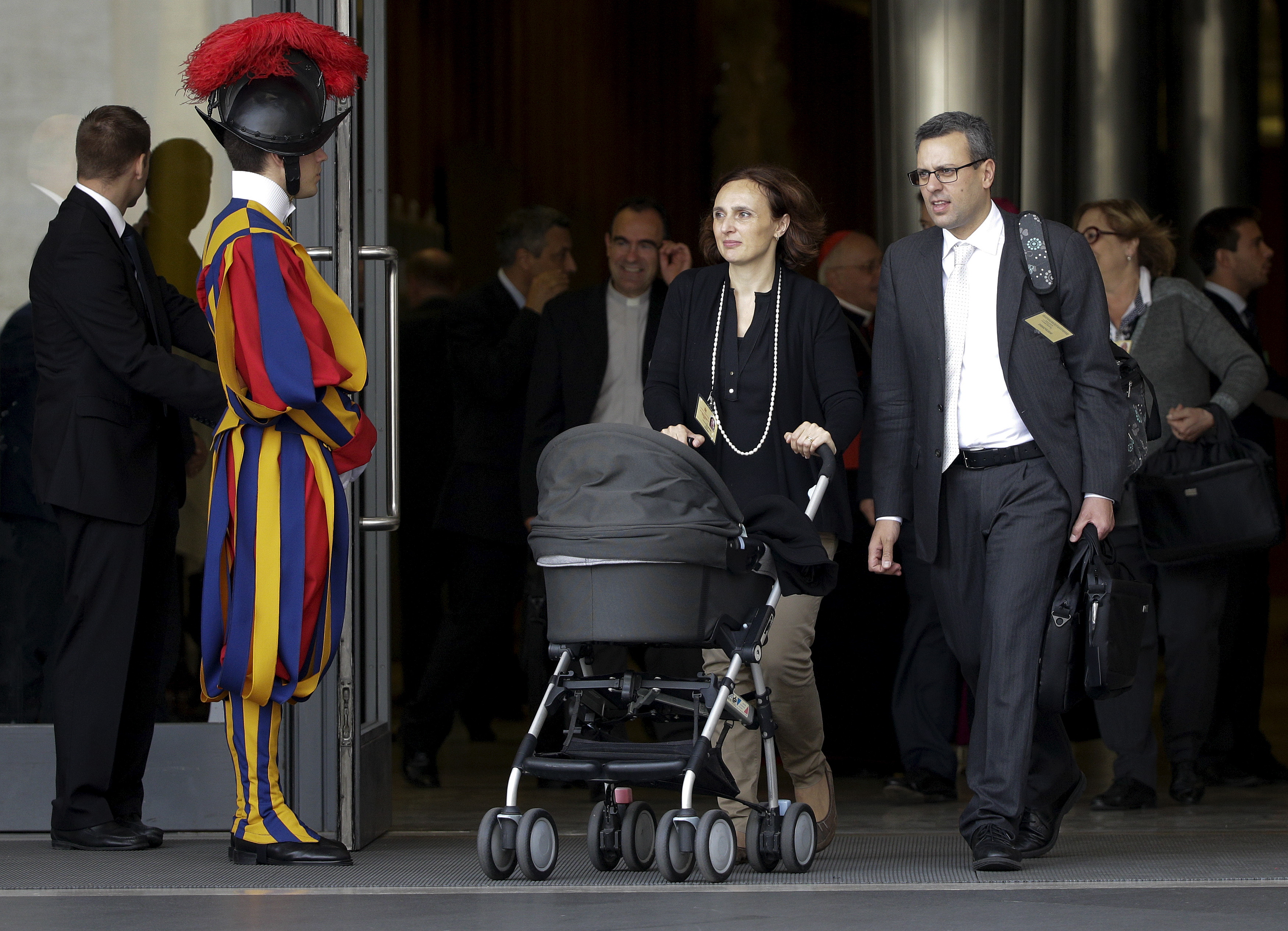 Attendees leave the synod of the family at the end of the morning session led by Pope Francis at the Vatican, Oct. 5, 2015.