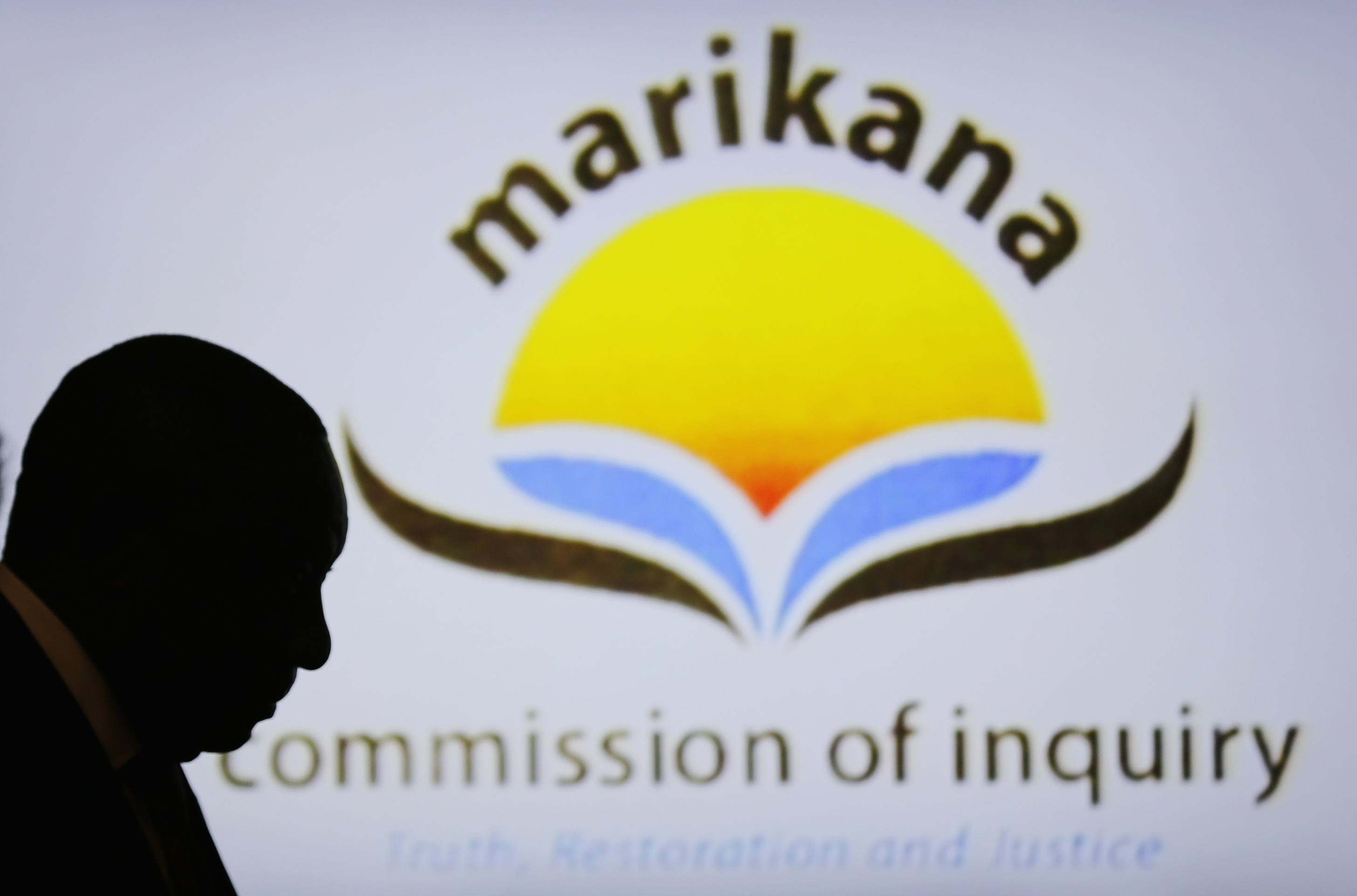South African Deputy President Cyril Ramaphosa is silhouetted in the Farlam Commission, Aug. 11, 2014. Ramaphosa is facing a probe into the 2012 Marikana killings of striking miners.