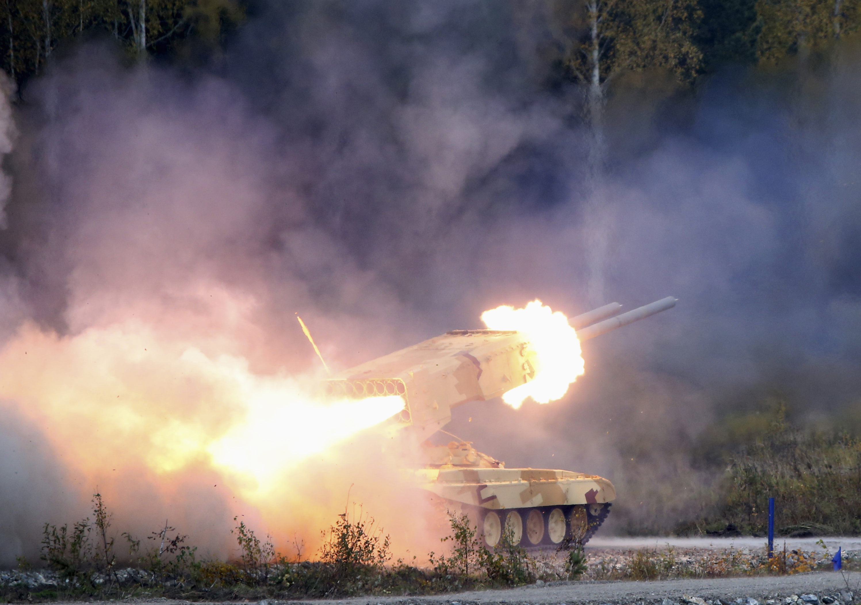 "A Russian ""TOS-1 Buratino"" multiple rocket launcher fires during the ""Russia Arms Expo 2013"" 9th international exhibition of arms, military equipment and ammunition, in the Urals city of Nizhny Tagil, September 25, 2013."