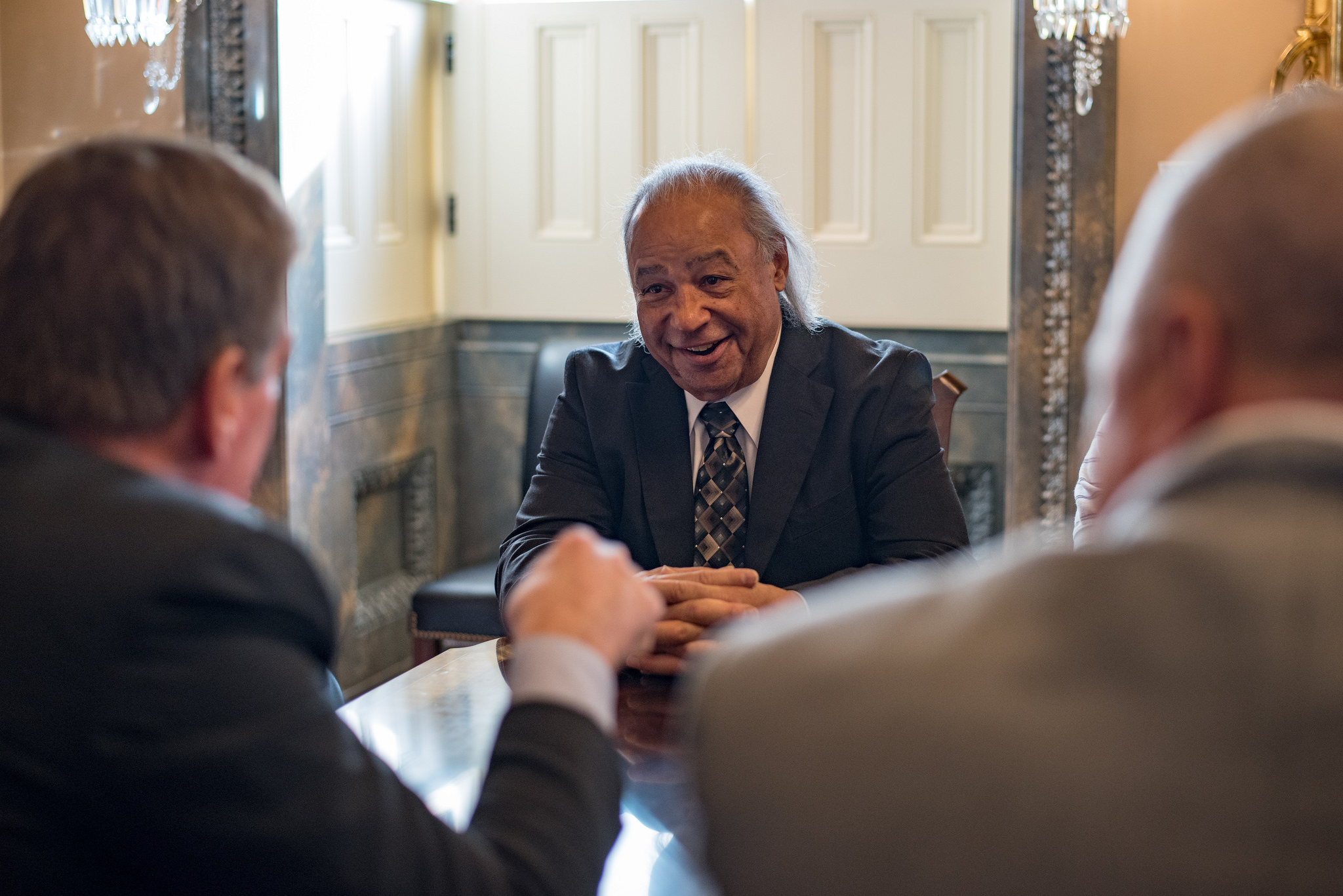 Photo shows Stephen R. Adkins (center), chief, Chickahominy Indian Tribe, in Senate Chamber just prior to Senate vote on the Thomasina E. Jordan Indian Tribes of Virginia Federal Recognition Act of 2017, Jan. 11, 2017. Courtesy: Senator Tim Kaine (D-...