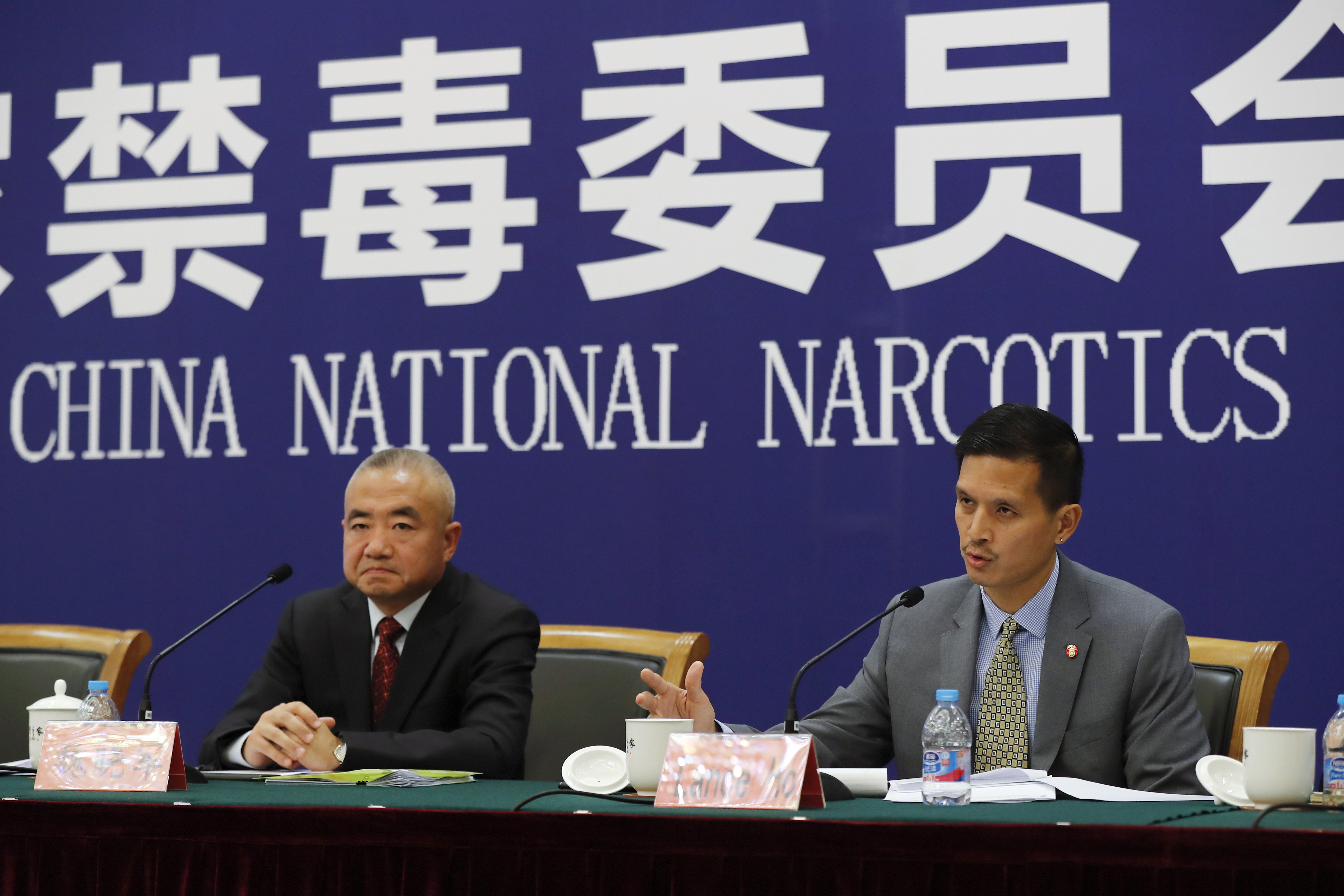 U.S. Drug Enforcement Administration's representative in Beijing, Lance Ho, right, speaks next to Wei Xiaojun, deputy director-general of the Narcotics Control Bureau of the Ministry of Public Security during a press conference in Beijing, Nov. 3, 20...