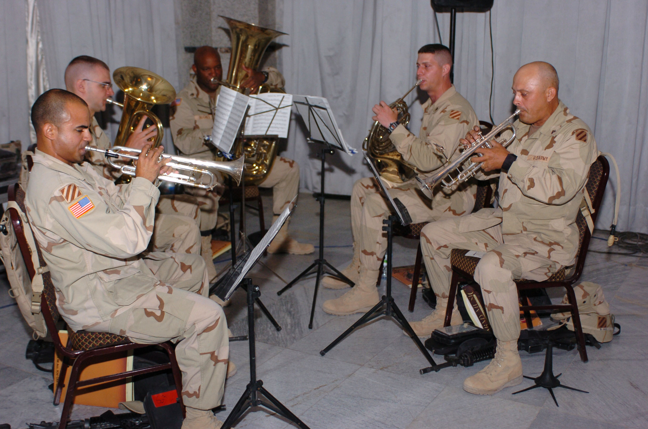 The brass ensemble from the 3rd Infantry Division Band, played a number of patriotic songs as part of the Memorial Day Remembrance Ceremony held at Al-Faw Palace on Camp Victory, Iraq. photo by Sgt. Michael J. Carden (released)