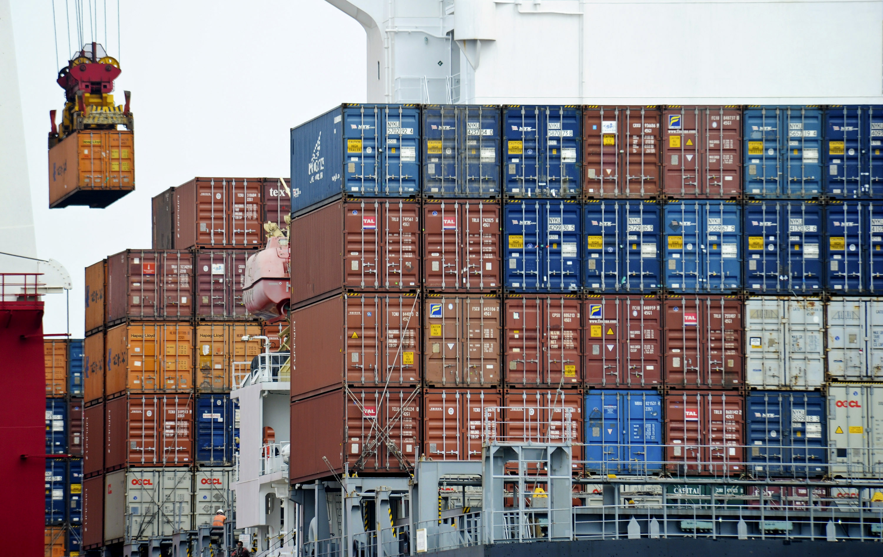 FILE - A container is loaded onto a cargo ship at the Tianjin port in China. The United States has formally told the World Trade Organization (WTO) that it opposes granting China market economy status, a position that if upheld would allow Washington