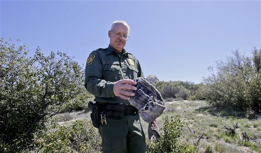 Border Patrol agent Richard Gordon holds a foot wrap made of carpet and wire which illegal immigrants use to disguise their footprints after entering the United States in the Boulevard area east of San Diego in Boulevard, California, March 25, 2013
