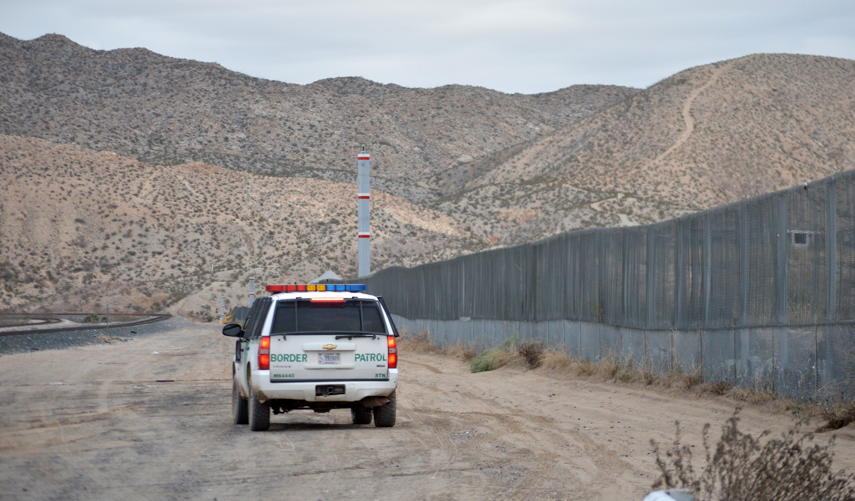 A U.S. Border Patrol agent drives near the U.S.-Mexico border fence in Sunland Park, New Mexico, Jan. 4, 2016.