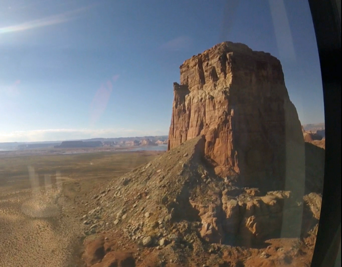 A helicopter ride is the best way to reach Tower Butte.
