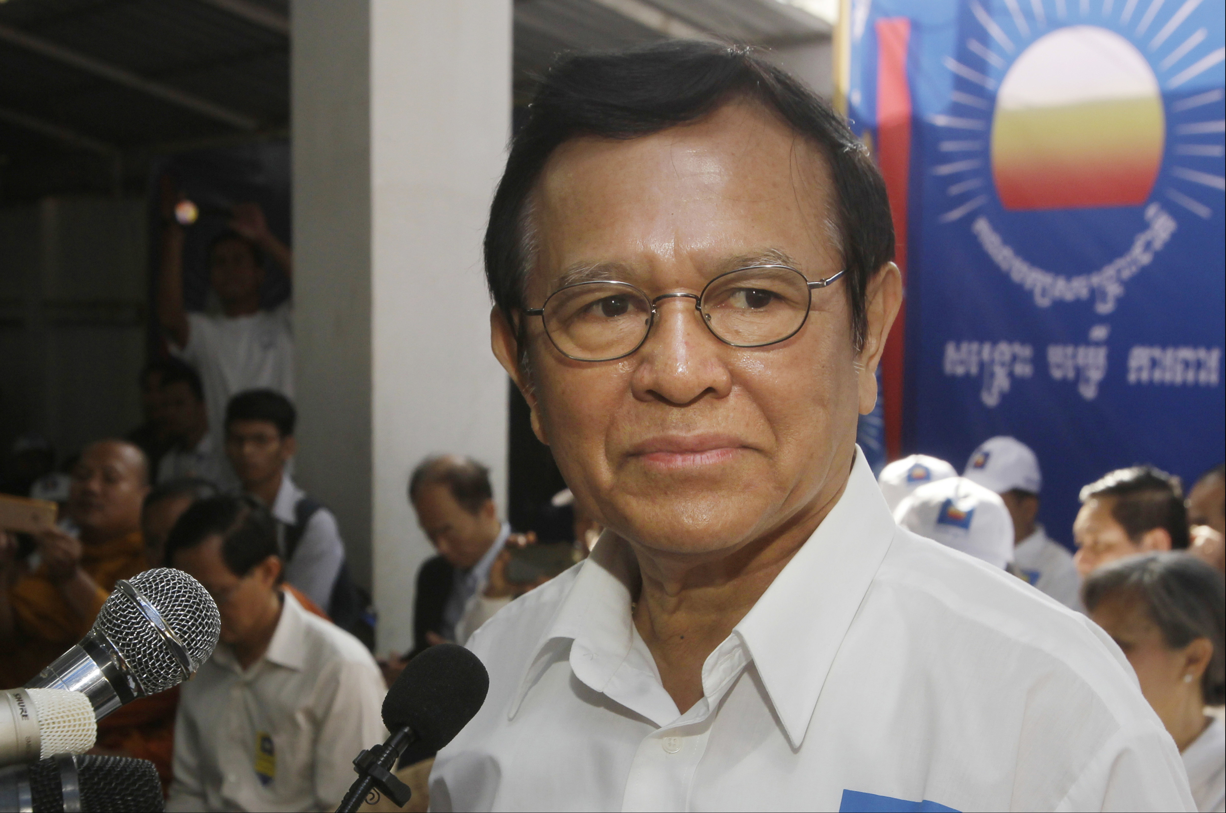 FILE - Opposition party Cambodia National Rescue Party (CNRP) President Kem Sokha adressess party supporters during the party's political congress in Phnom Penh, Cambodia, March 2, 2017.