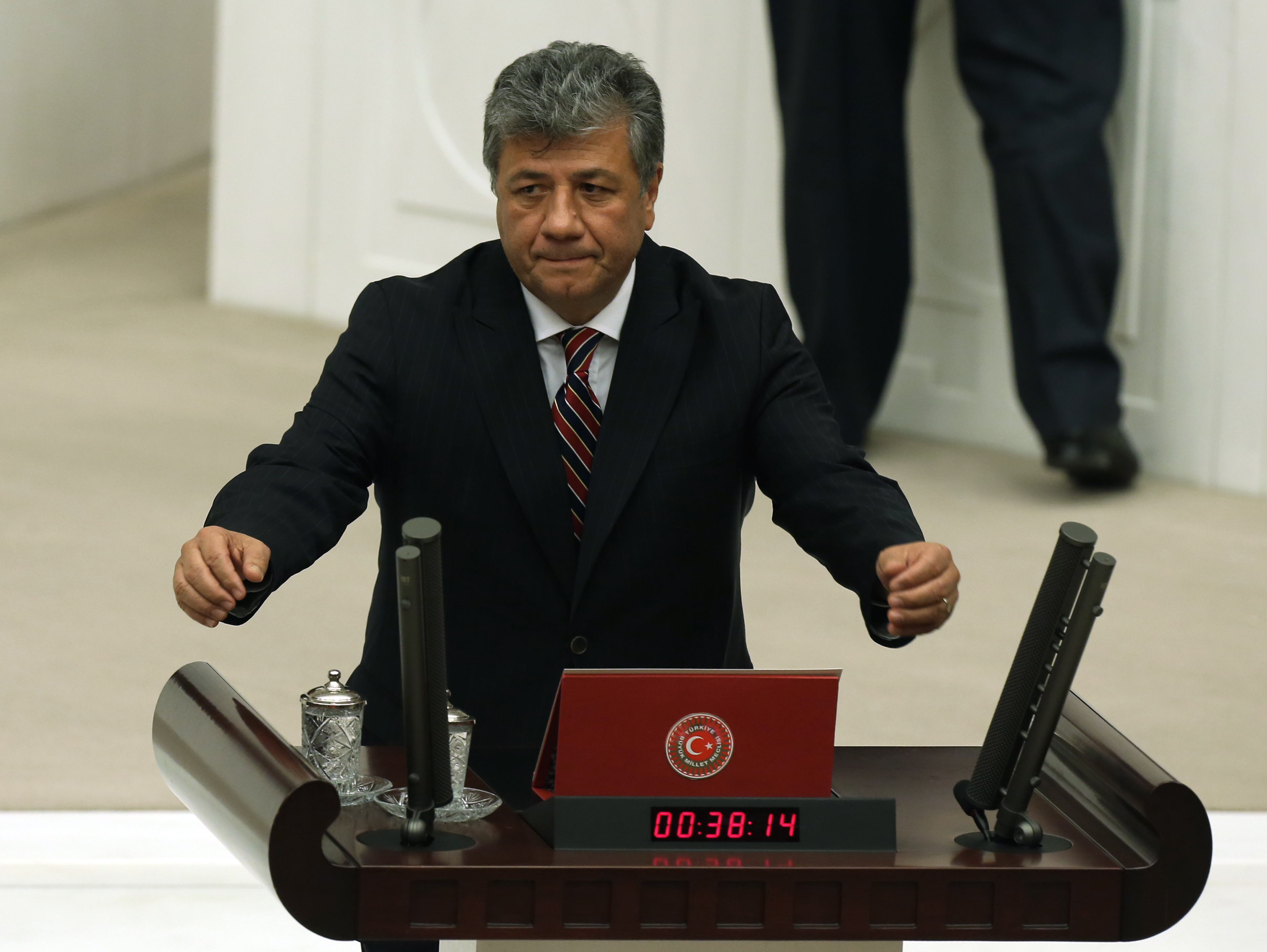 FILE - Mustafa Balbay, a Turkish journalist who was elected a lawmaker, takes his office oath at the parliament, Nov. 17, 2015, after spending nearly five years in jail, in Ankara, Turkey.