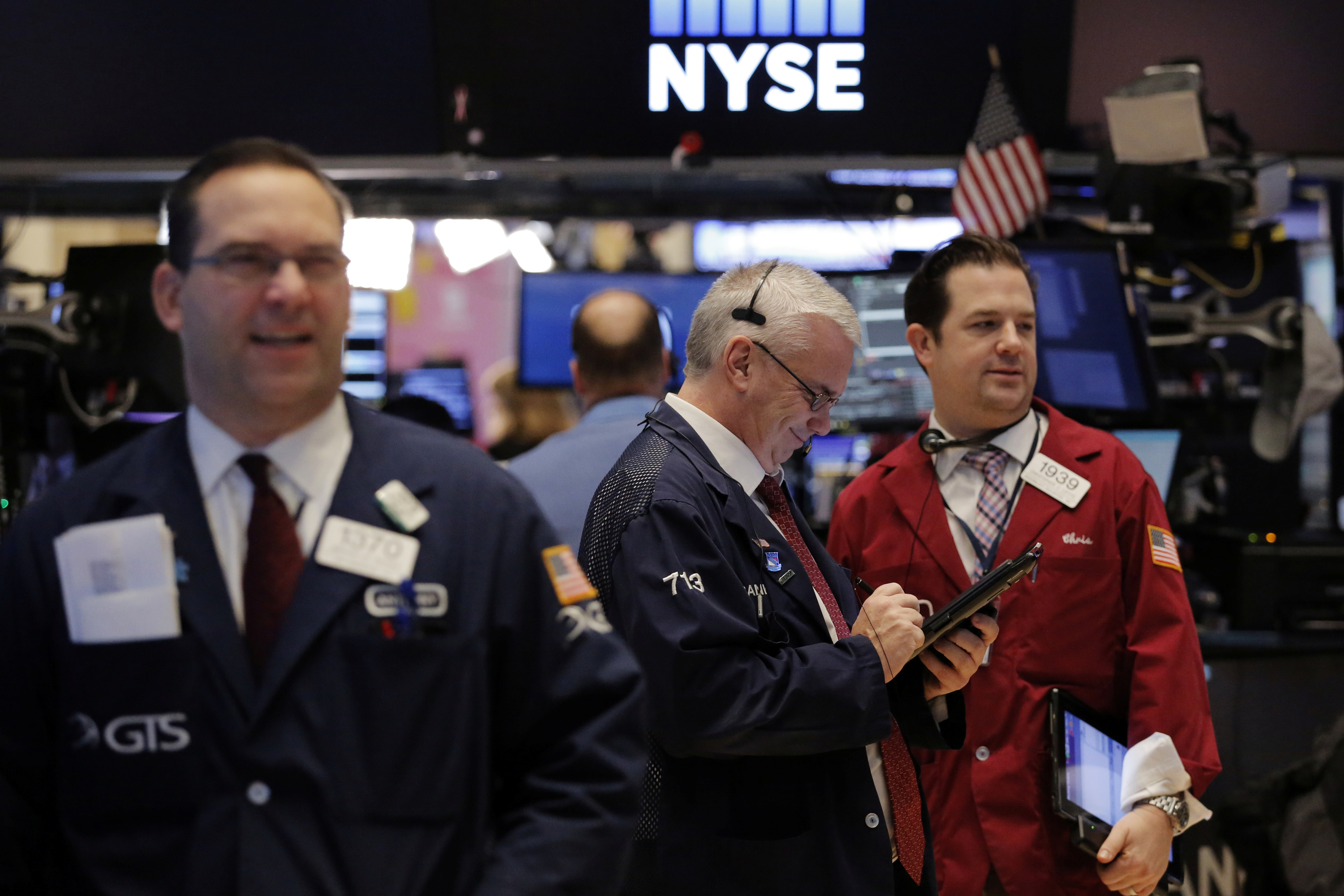 Traders work on the floor of the New York Stock Exchange shortly after the opening bell in New York, Jan. 13, 2017.