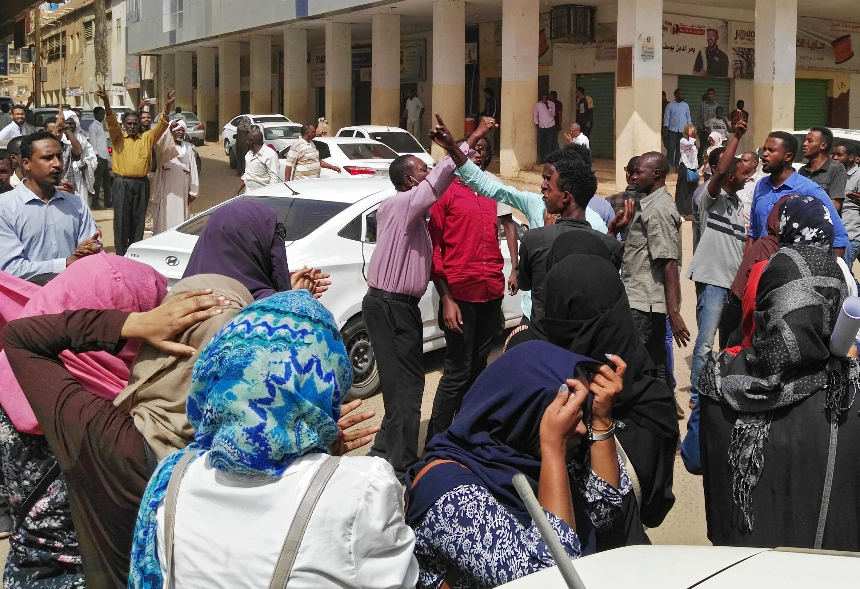 Sudanese protesters take part in an anti-government demonstration in Khartoum, Feb. 14, 2019.