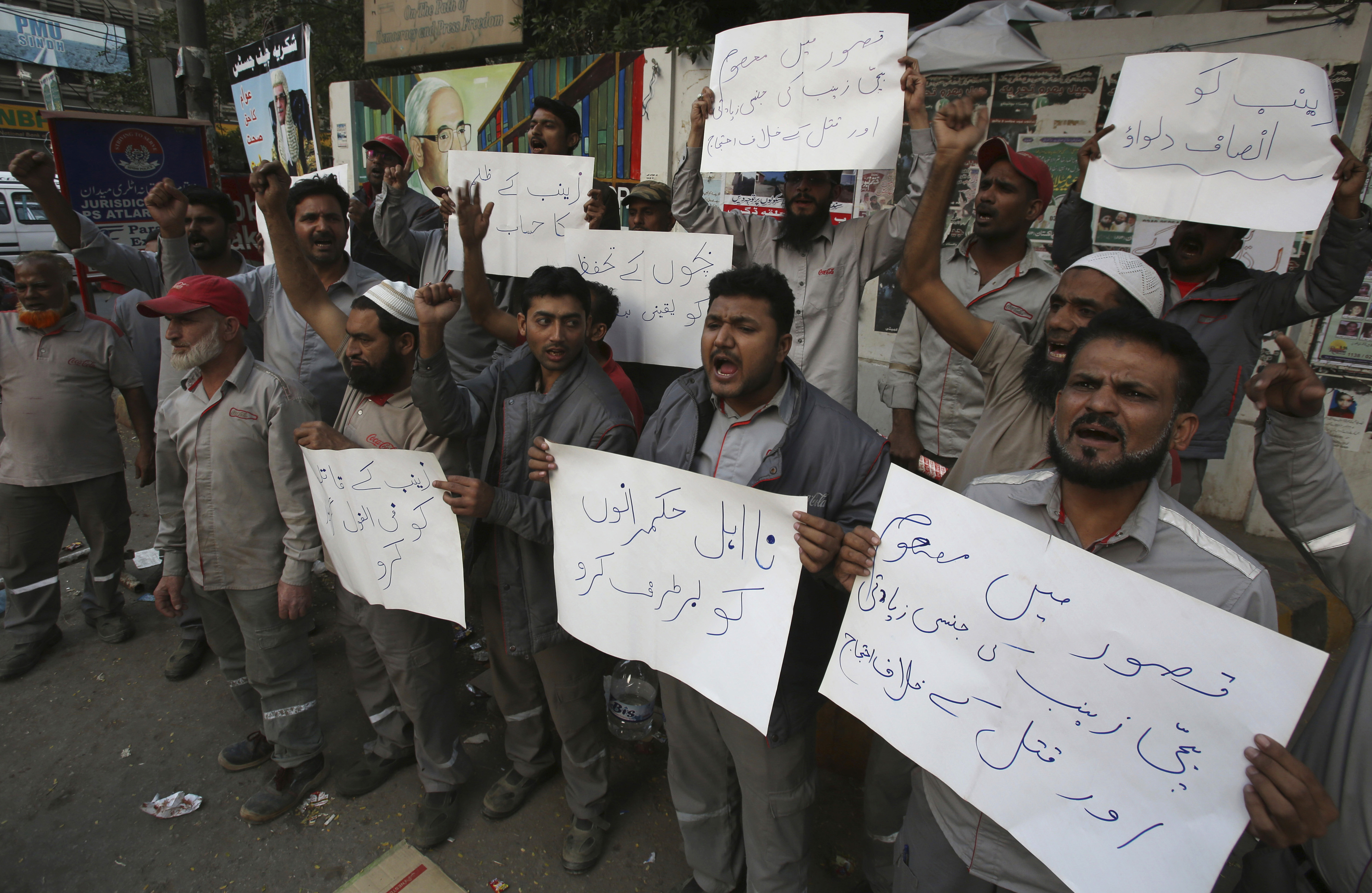 """Pakistani civil society activists protest against the rape and killing of a young girl, in Karachi, Pakistan, Jan. 10, 2018. Placard at bottom center reads"""" remove the incompetent rulers."""""""