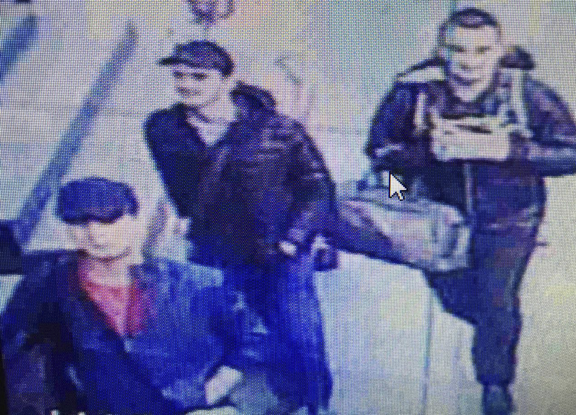 In this photo made from a video, people believed to be the attackers walk in Istanbul's Ataturk airport, June 28, 2016. Turkish authorities have banned distribution of images relating to the Ataturk airport attack within Turkey.