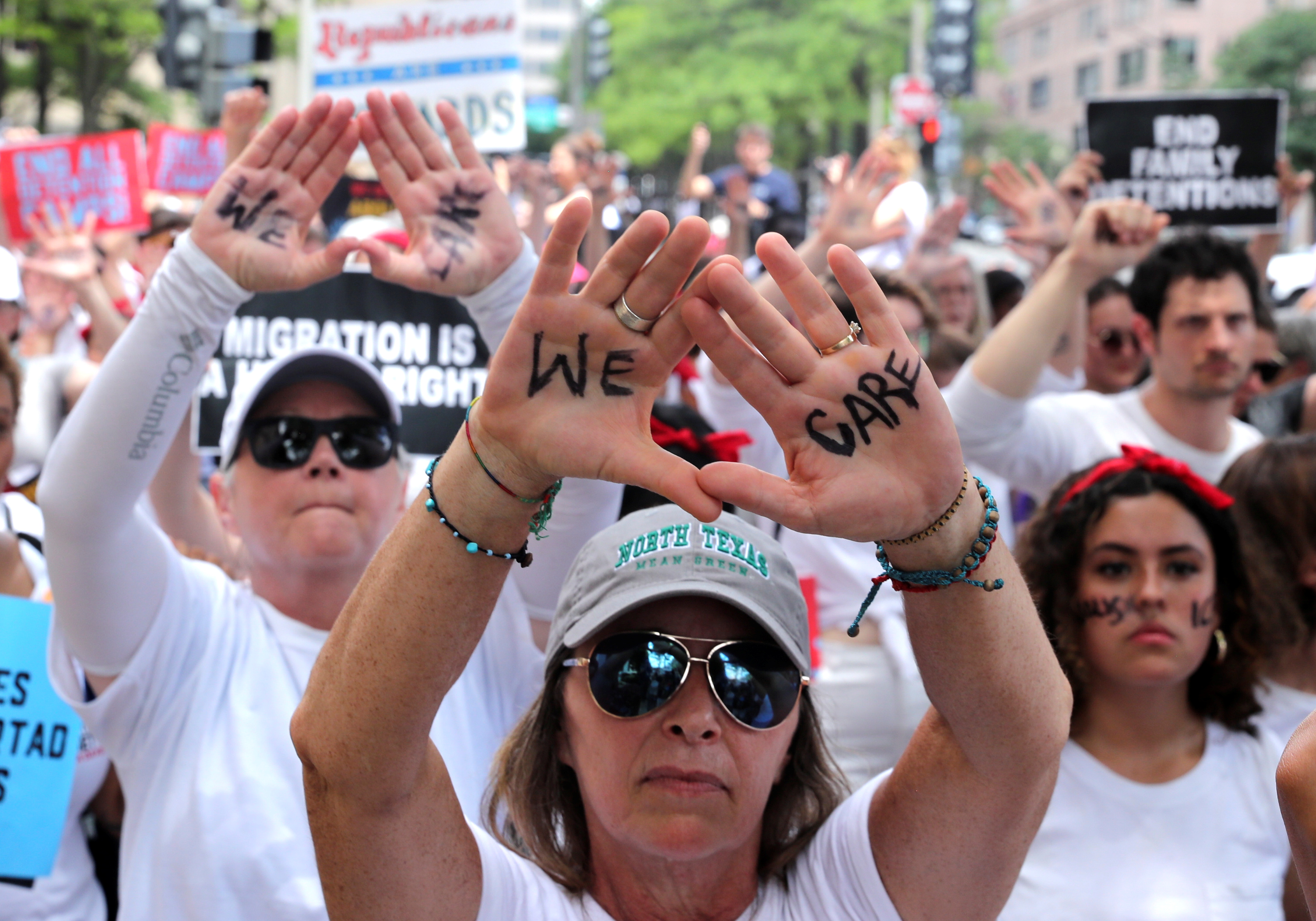 "Immigration activists rally as part of a march calling for ""an end to family detention"" and in opposition to the immigration policies of the Trump administration, in Washington, June 28, 2018."