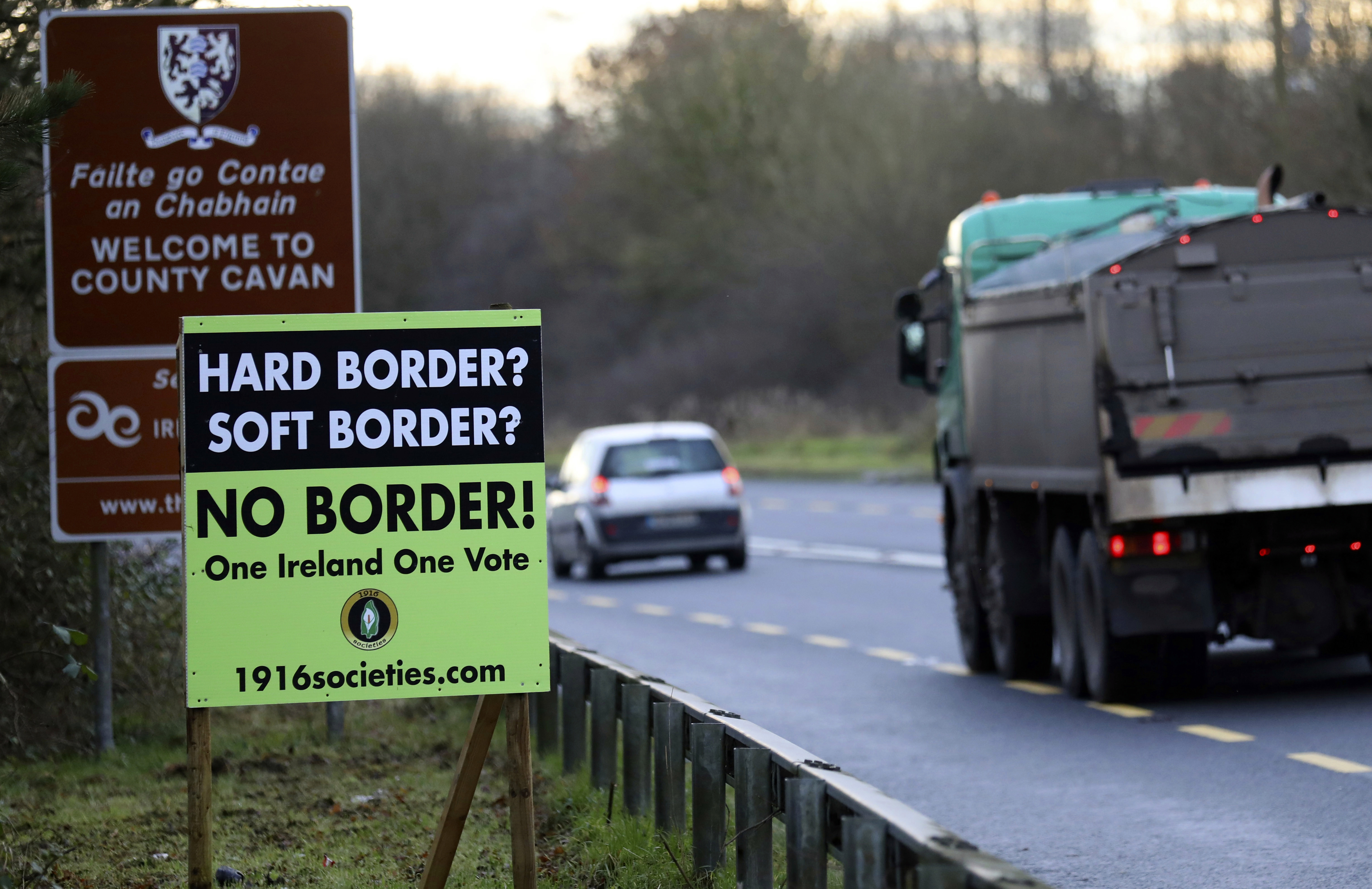 A poster against a hard border stands on the border between Northern Ireland and the Republic of Ireland near the town of Derrylin, Northern Ireland, Dec. 12, 2018.