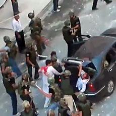 An grab taken on June 27, 2011 from footage uploaded on YouTube on June 24 allegedly shows Syrian security forces beating two men with batons and shoving them in the trunk of a car in Barza on the outskirts of Damascus (editorial content, date and lo...