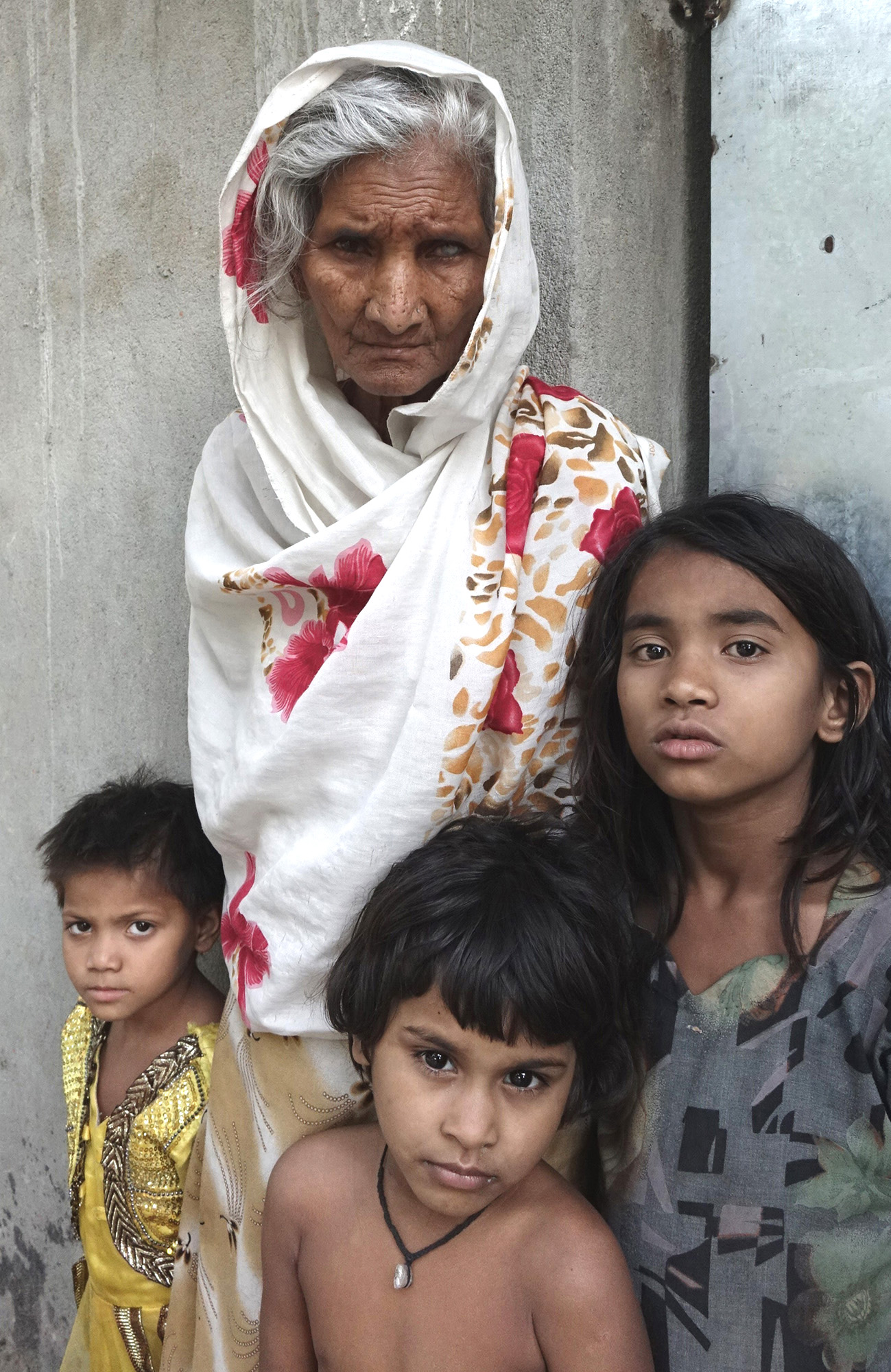 Some Rohingya children and a woman at an unidentified refugee colony in West Bengal, eastern India (April 2018).