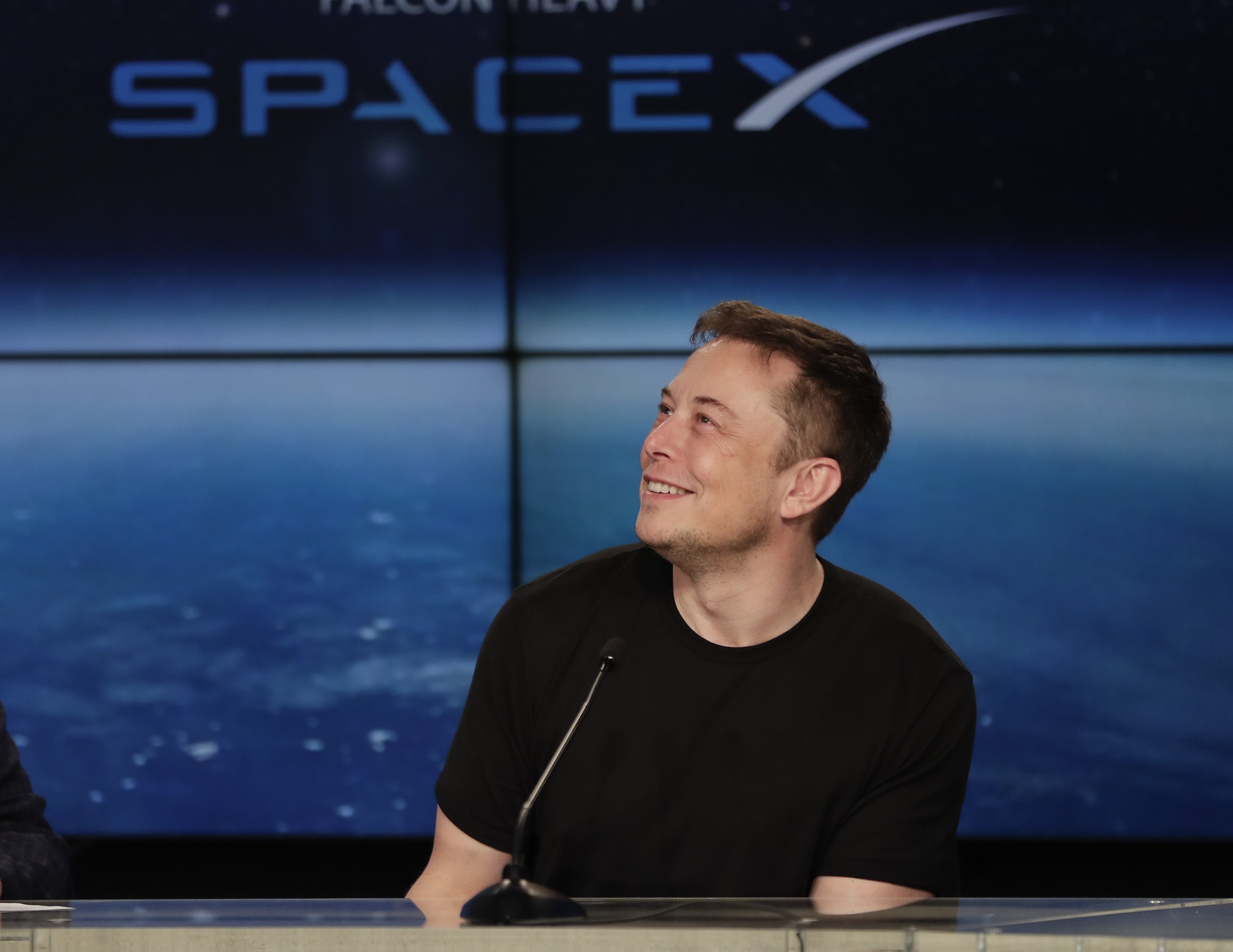 Elon Musk, founder, CEO, and lead designer of SpaceX, speaks at a news conference after the Falcon 9 SpaceX heavy rocket launched successfully from the Kennedy Space Center in Cape Canaveral, Florida, Feb. 6, 2018.