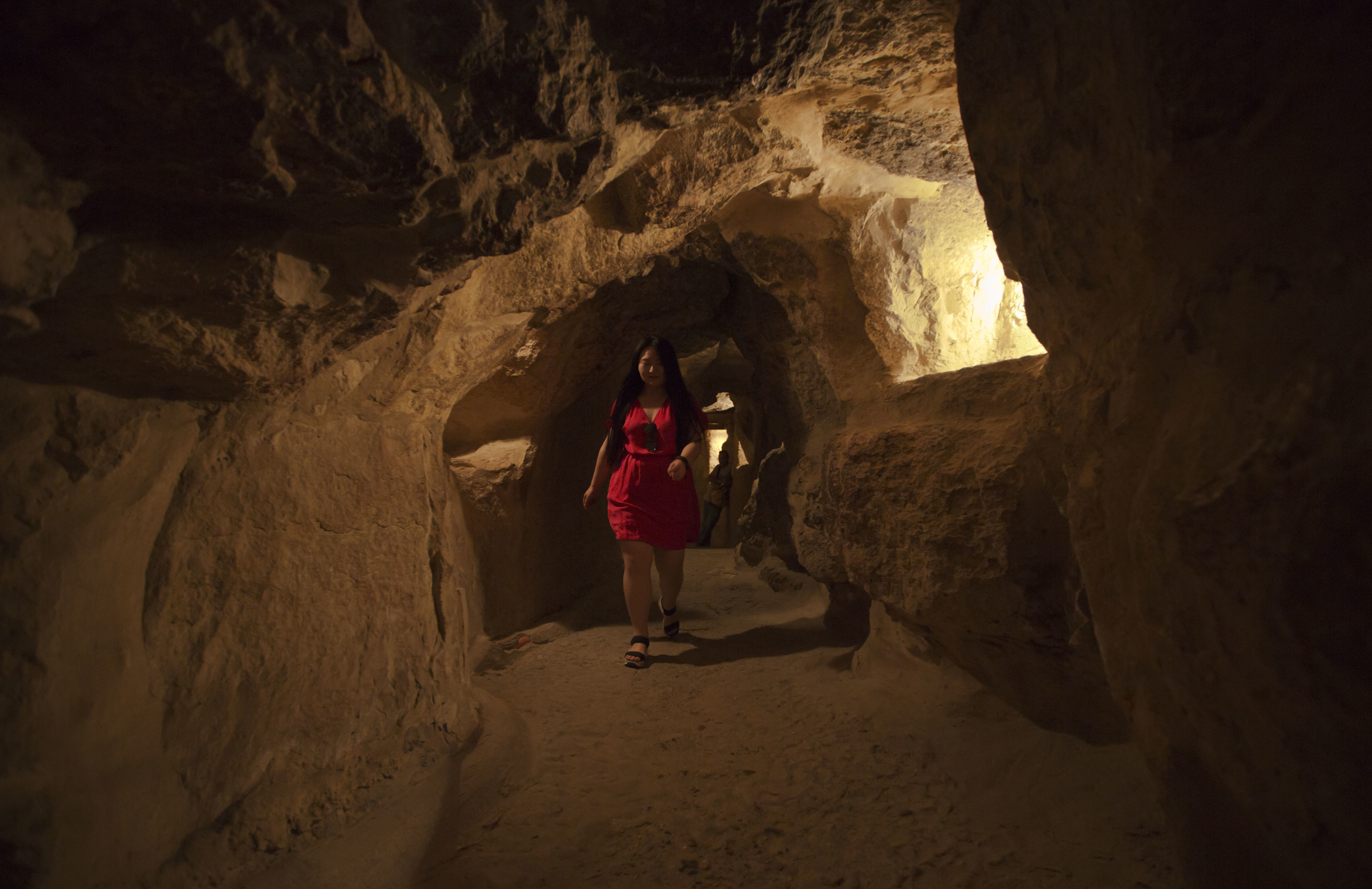 FILE - A tourist visits the inside of the Great Pyramid, built by Cheops, known locally as Khufu in Giza, Egypt, June 2, 2016.